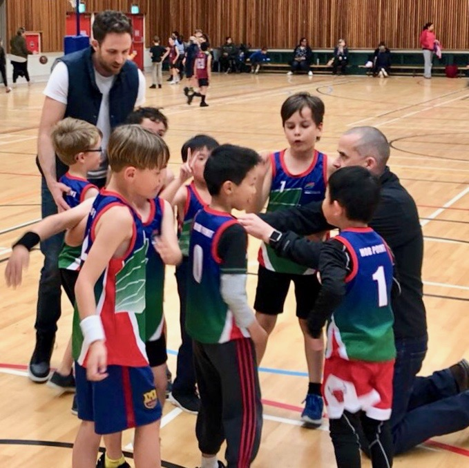 Nate and another dad coaching basketball