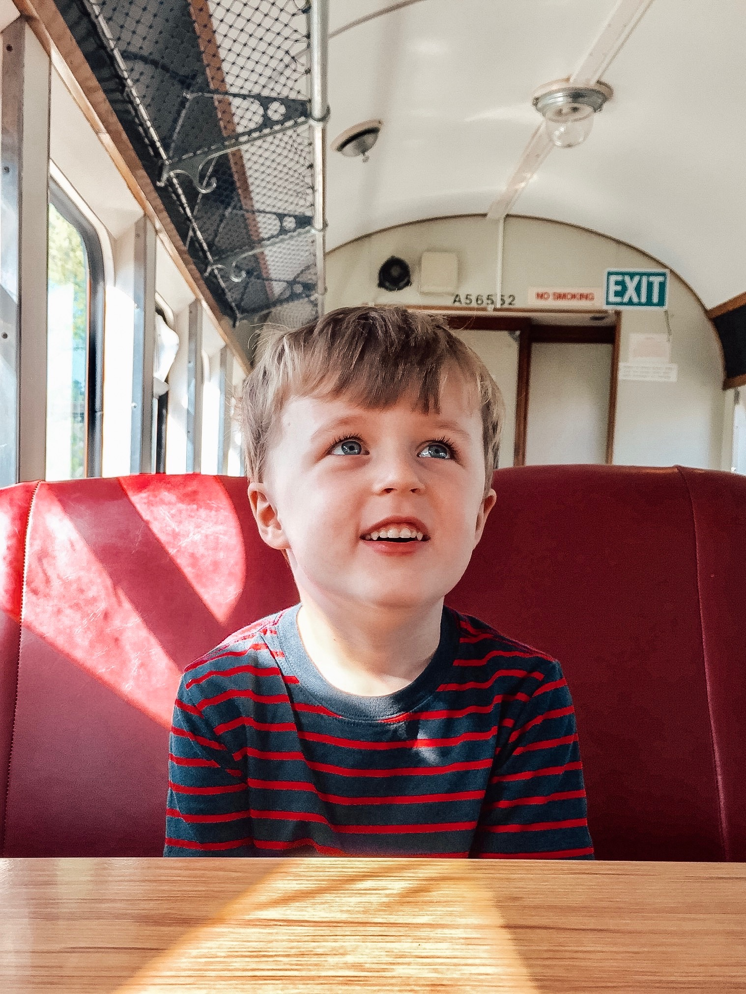 "This cutie. Finn loves having a ""coffee"" with Daddy in this local train-car cafe."