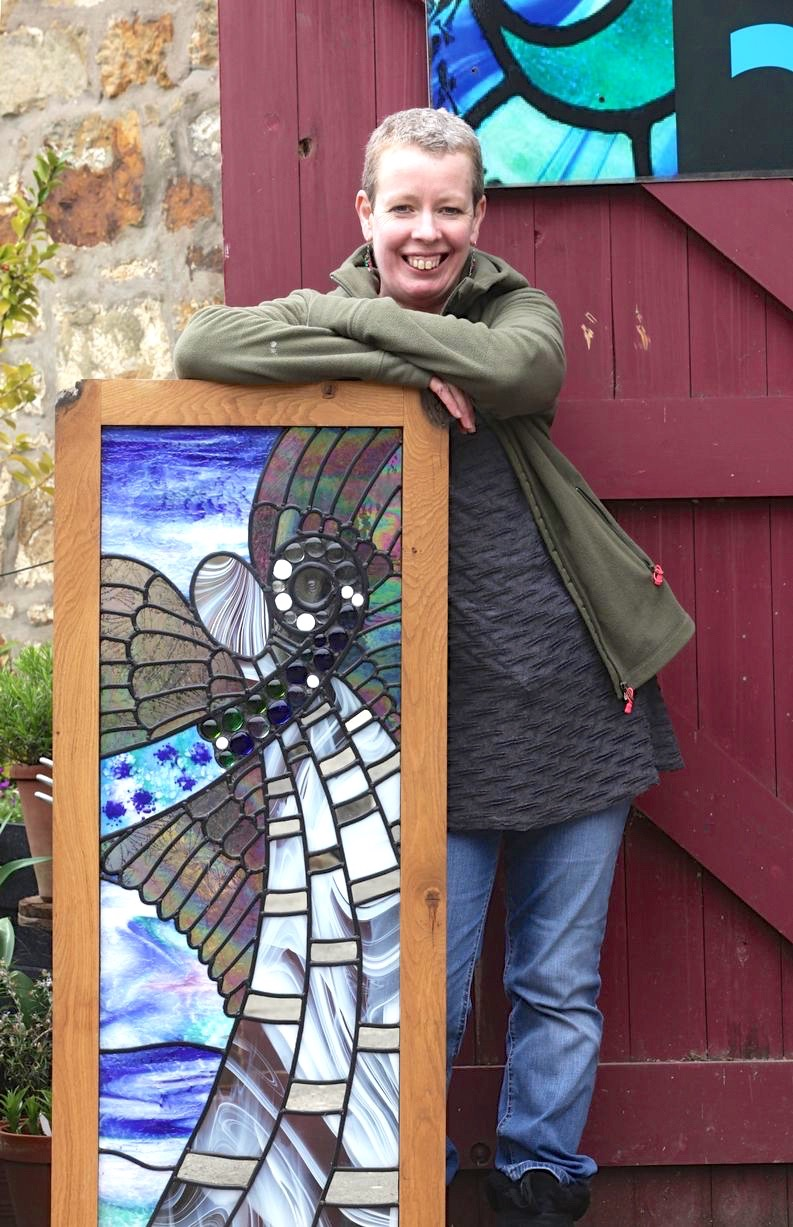 helen grierson with her hexham angel leaded glass panel