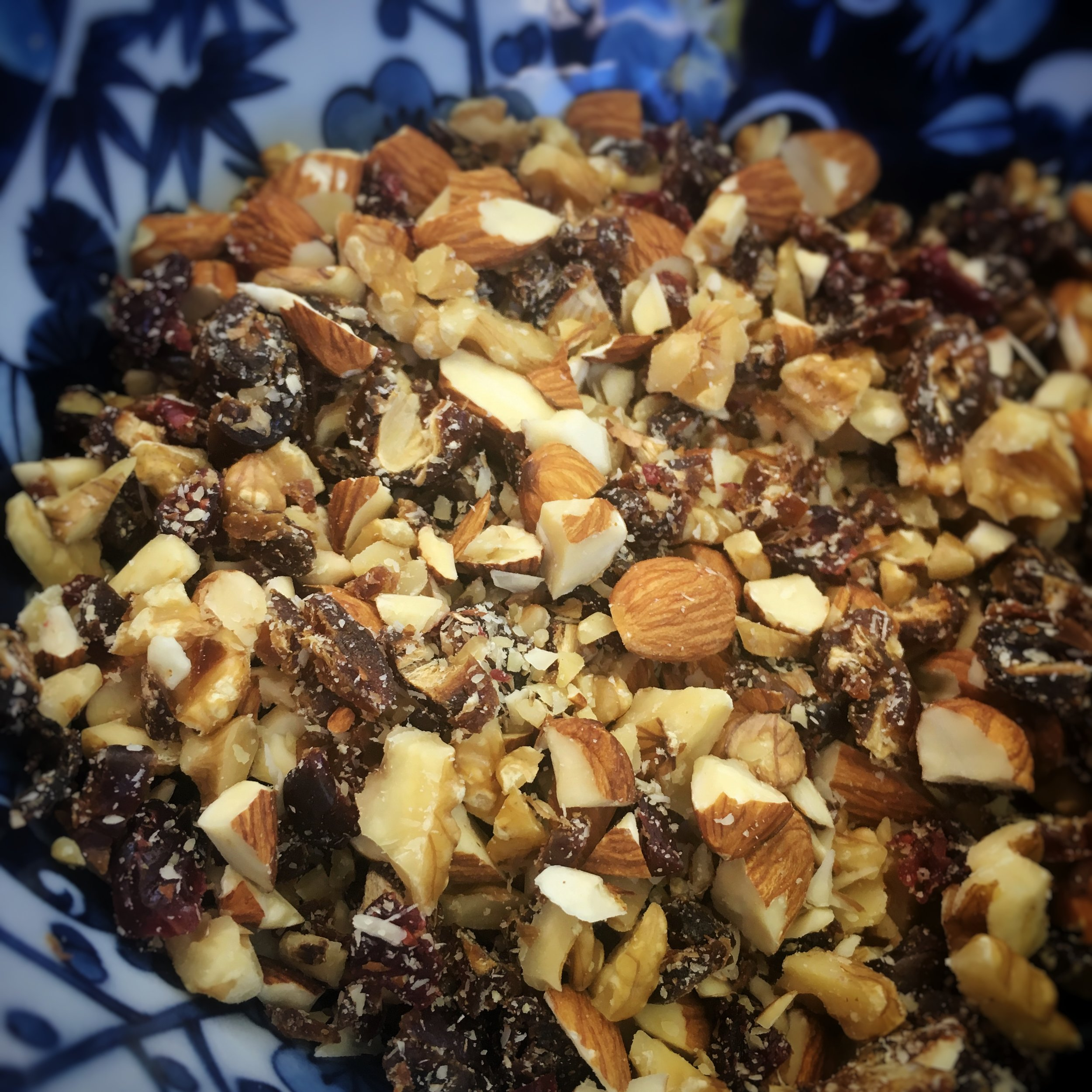 Roughly chop your fruit and nuts and mix them evenly in a bowl - Try not to eat this yummy deliciousness yet...