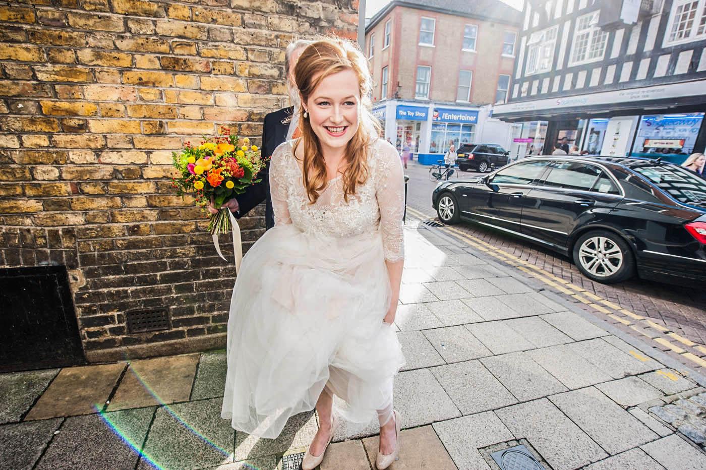 BRIDE-ARRIVES-HOLDING-UP-DRESS.jpg