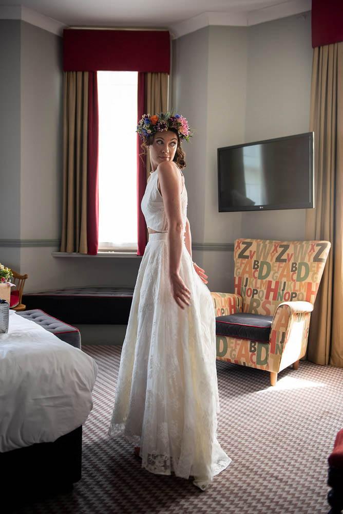 BRIDE-CHECKS-DRESS-IN-MIRROR.jpg