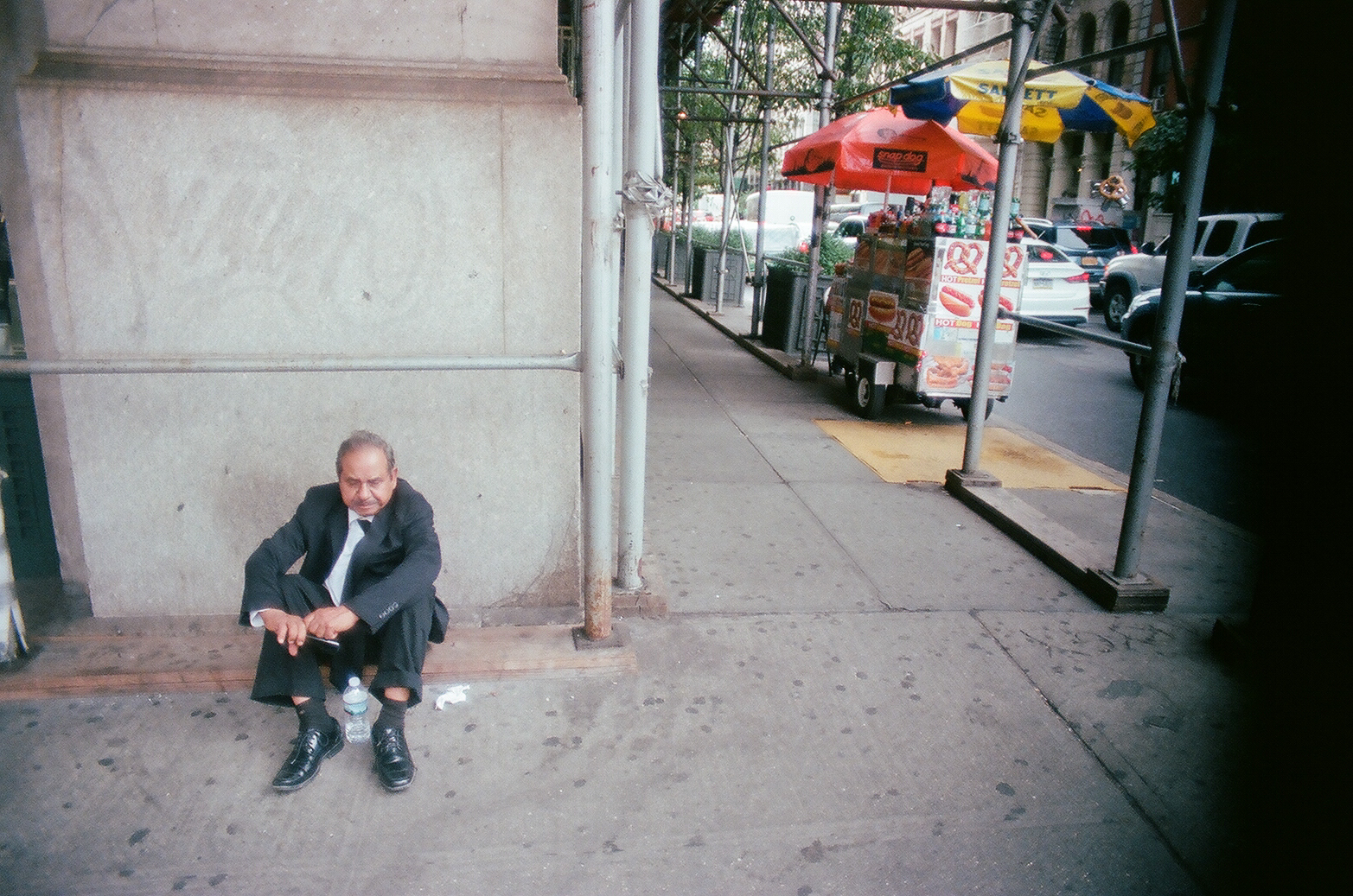 Man in Suit sitting on Sidewalk, Manhattan_Film Photography_NYC_Joe Curry Photography_2018.jpg