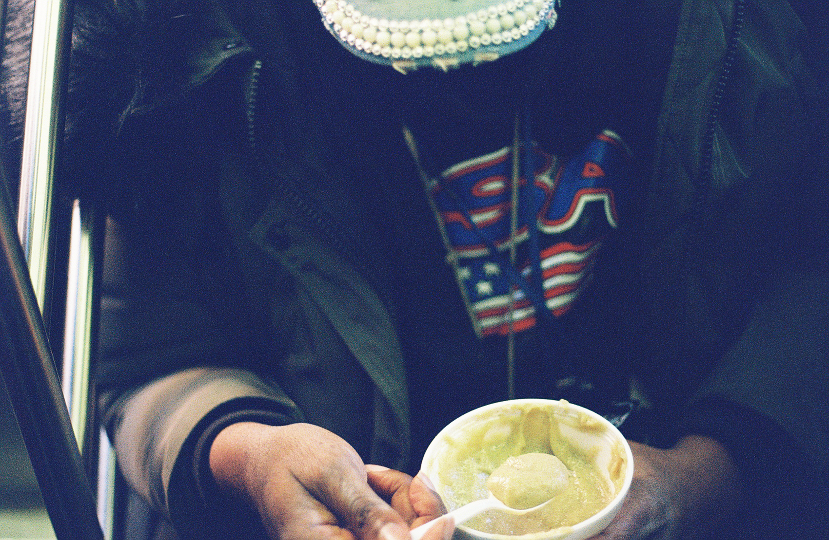 Man eats on the Subway_Film Photography_NYC_Joe Curry Photograph