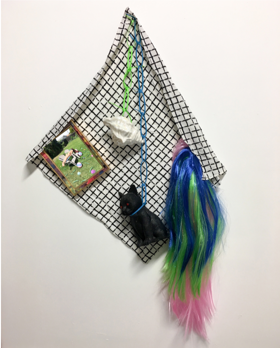 "Mama's Backyard Won't Do , 2019, fabric, plastic cat, ceramic shell, synthetic wig, frame, digital photograph, push pins, zip ties, 36"" x 24"" x 5"""