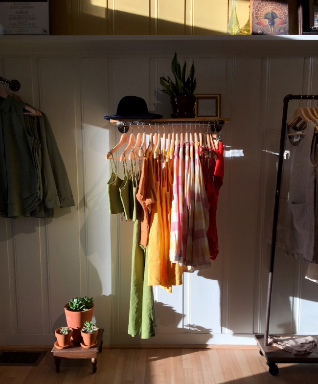 One day in early Spring the sun shifts and hits our wall at a certain time of day. The stark light only lasts for about 20 minutes each day for a month and then disappears and doesn't return in the same photogenic manner until the same time the following Spring. Featured here, all on one rack, are beautiful pieces from Paloma Wool, Baserange, Atelier Delphine, Jungmaven, and Woolrich.