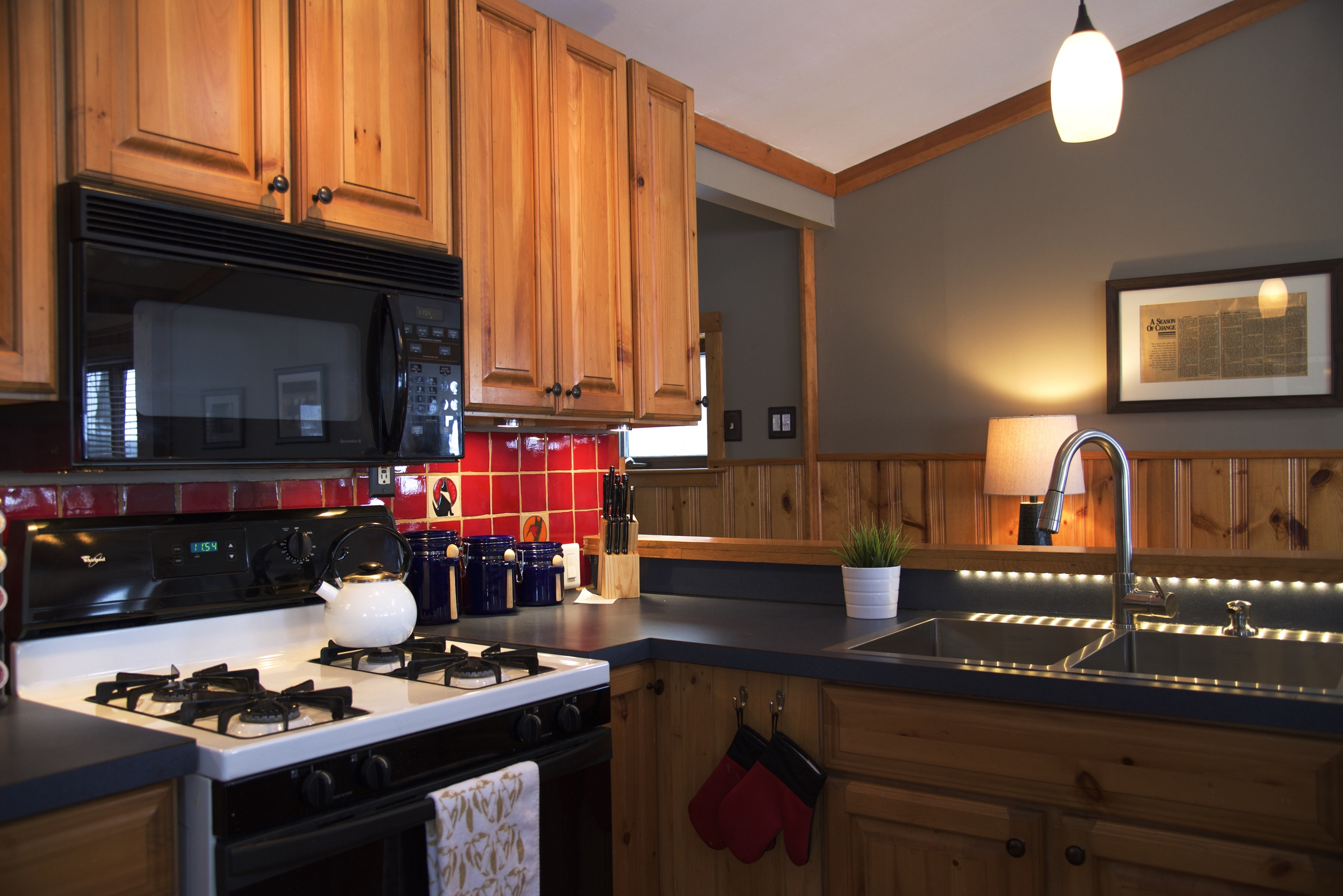 Fully-equipped kitchen with gas range.