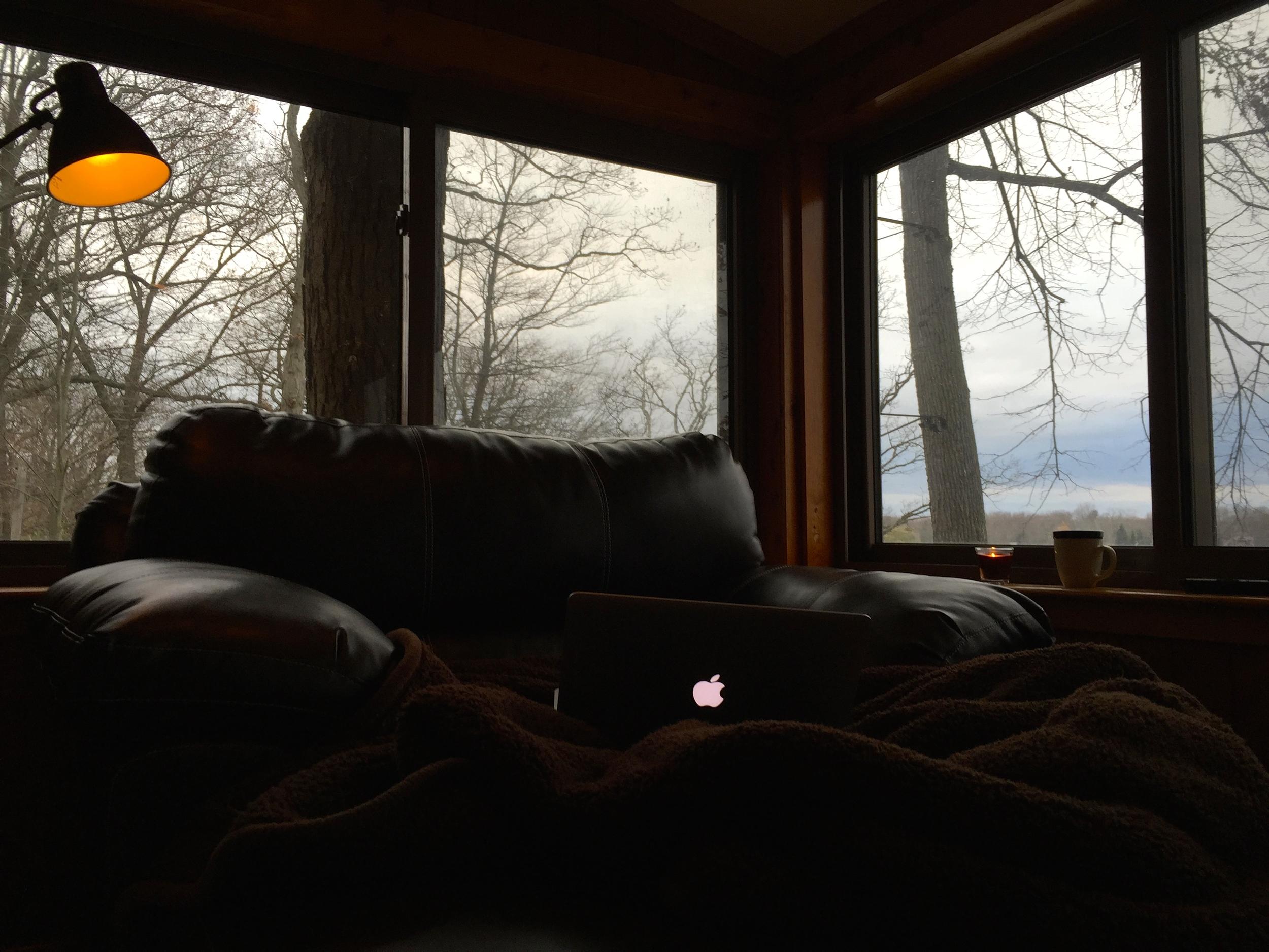 Oversized sofa chair overlooking lake.