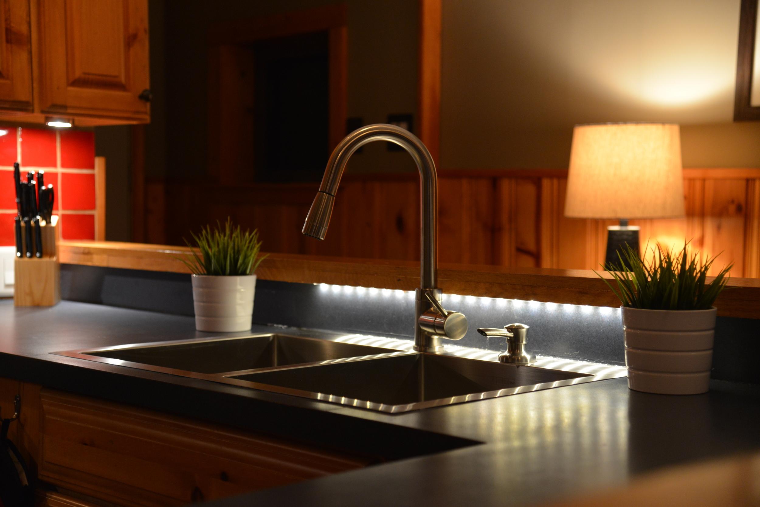 Under-cabinet & sink accent lighting.