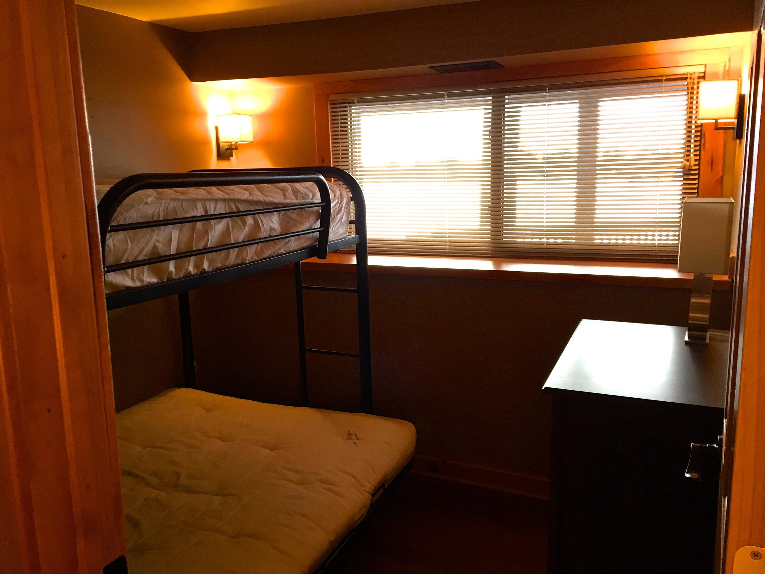 Smaller bedroom that sleeps 3.