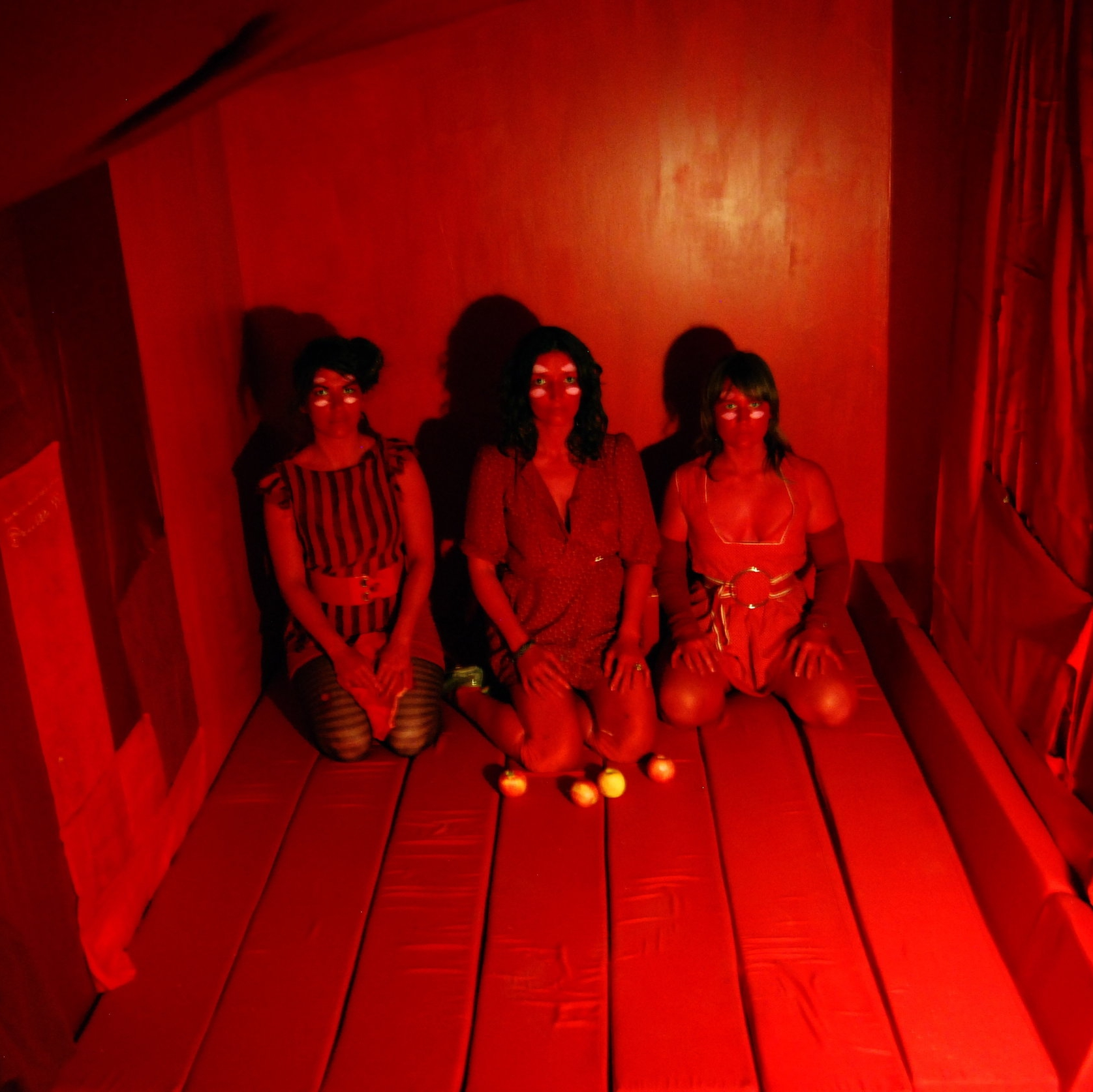 "'Red Room' installation, interactive performance by Adriana Atema ""A Light in the Basement"" Stanhope Cellar Studios, Brooklyn NY 2011    Red Room assistants: Serra Victoria Bothwell Fells, and Vnessa Wolfchild"