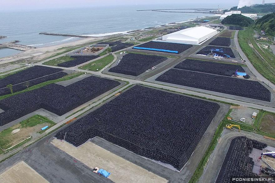 photo by Arkadiusz Podniesinski,    Fukushima Daiichi Exclusion Zone   , plastic bags of radioactive, nuke garbage sitting along the Pacific coastline