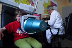 10-year-old Oksana receives a yearly check for radioactive elements.    Photo Credit: Associate Press
