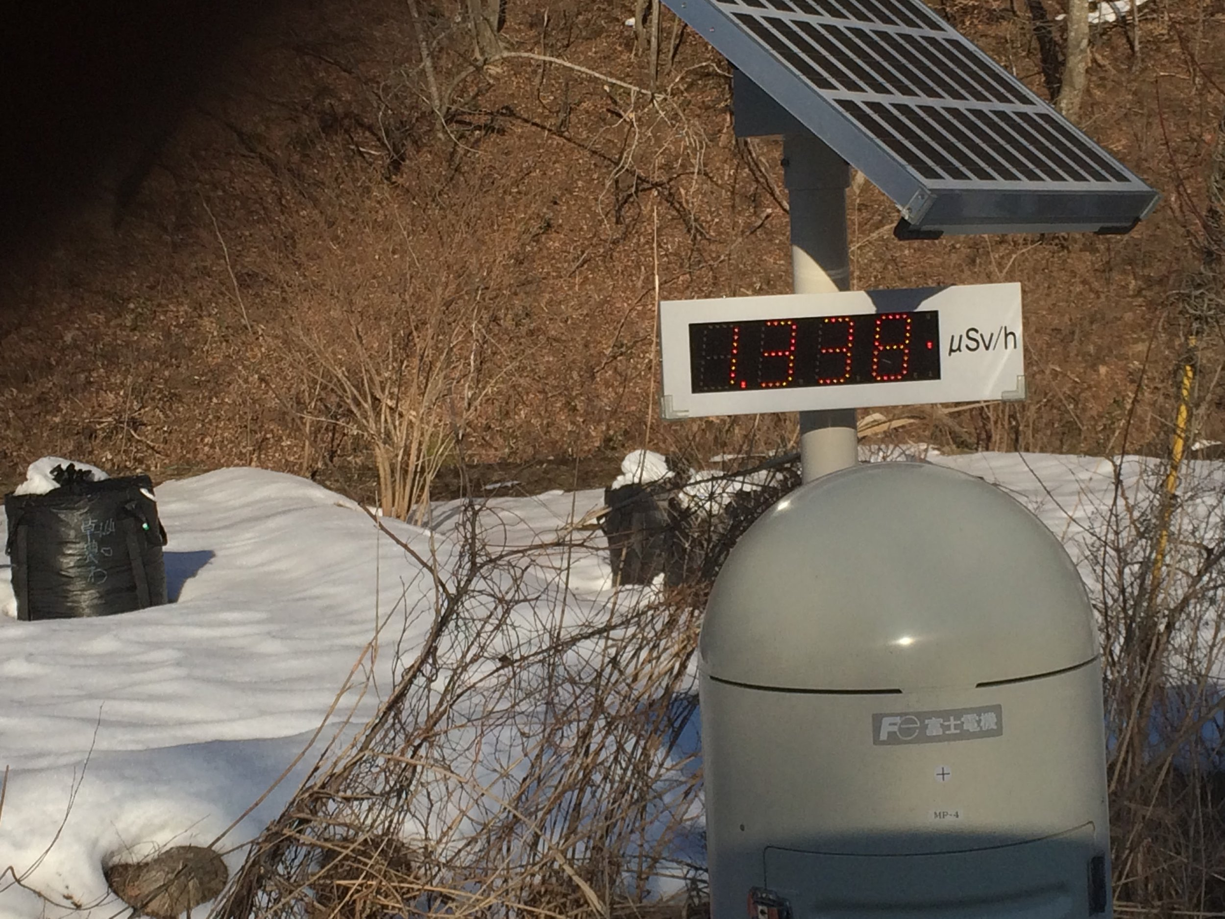 One of many solar powered radiation detectors on the side of the road. Normal background radiation is 10x lower.