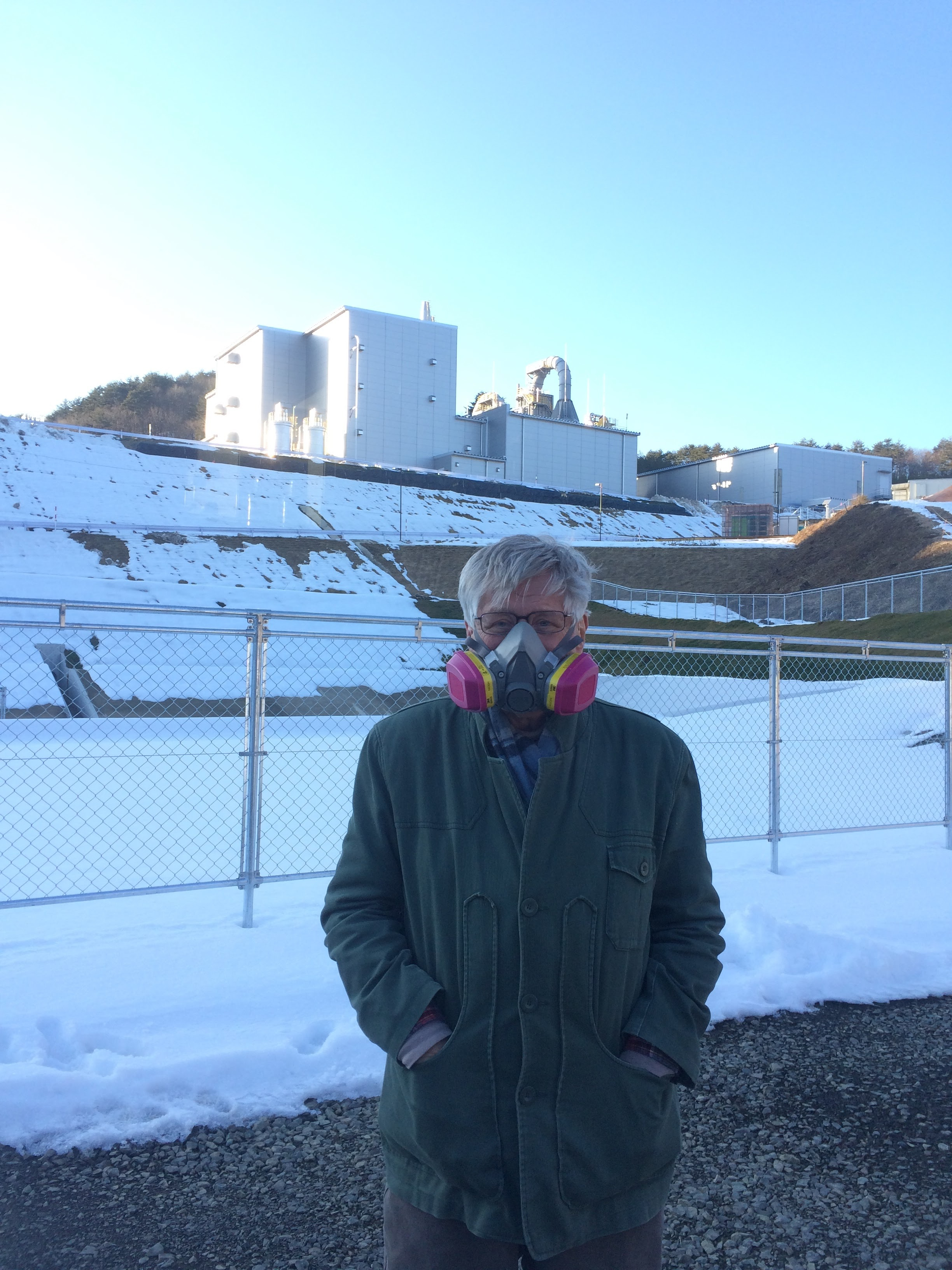 Wearing my respirator in front of the nuclear waste incinerator.