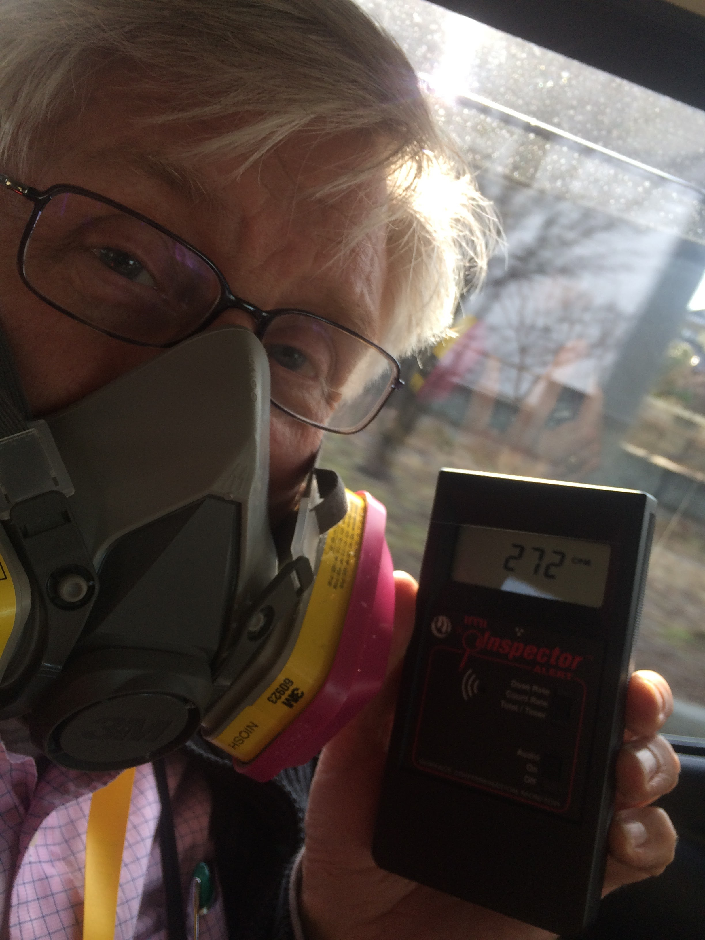 Driving through contaminated town. Windows up. Normal background radiation is more than 10x lower. Love that respirator!