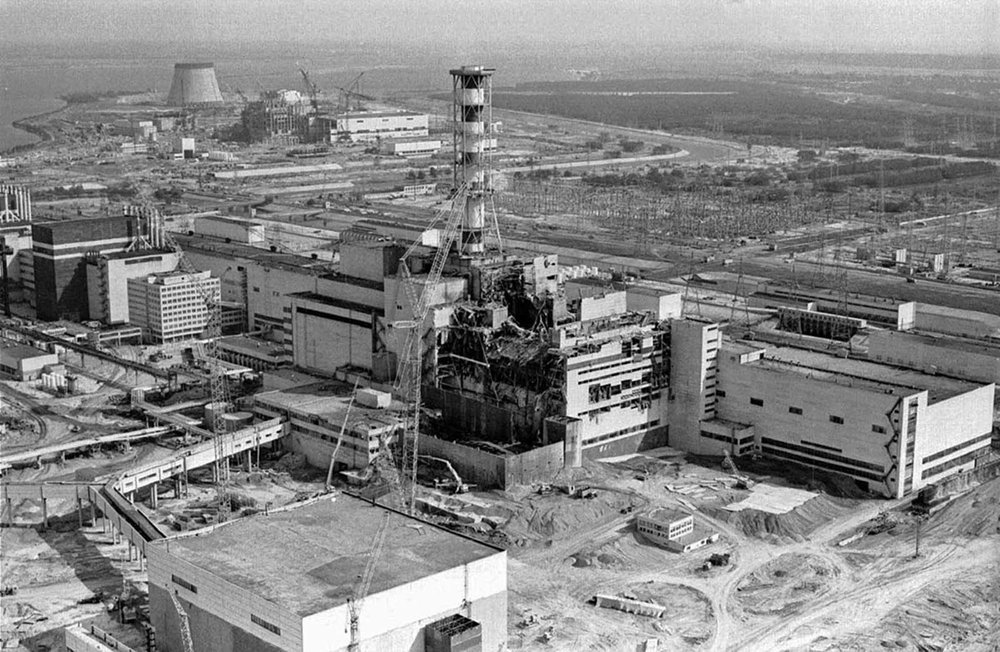 An aerial view of the damaged Chernobyl nuclear plant undergoing repair and containment work in 1986.  Photo Credit .