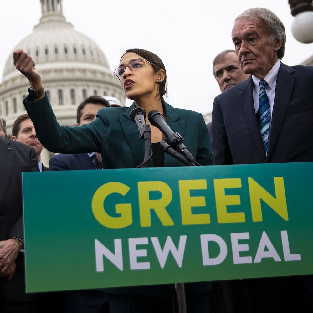 "Rep. Alexandria Ocasio-Cortez (D-N.Y.) speaks during a news conference to unveil the Green New Deal resolution. Ocasio-Cortez said she still has an ""open mind"" on nuclear energy and differentiates between the decades-old plants in the United States and more advanced technologies under development.  Photo  Credit : AL DRAGO/BLOOMBERG"
