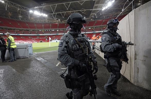Counter terrorism specialists patrol Wembley prior to the match - shared on  fancred  by  landon howell
