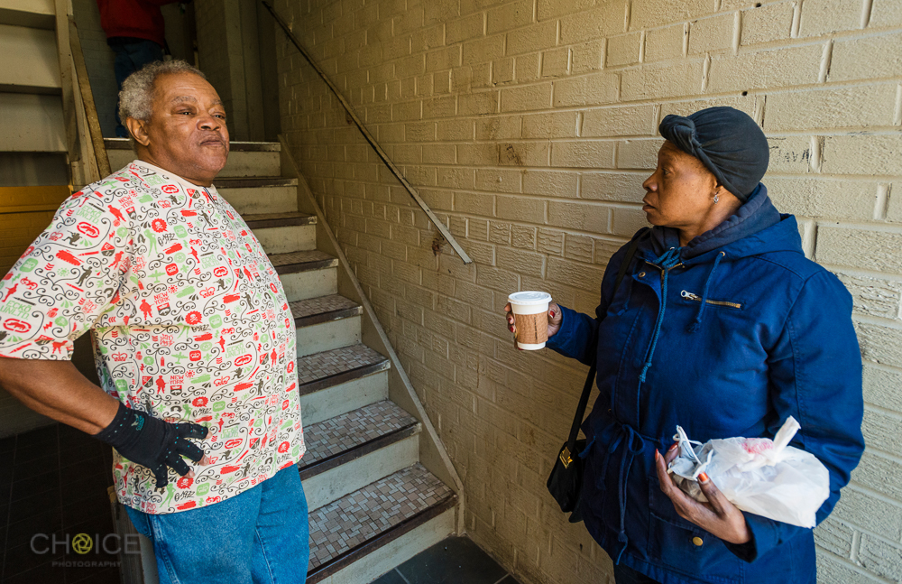 Robert Green and his neighbor Lonise, discuss living conditions at their apartment building near 13th and Alabama Avenue, SE, Washington, D.C. November 10, 2016 (Rodney Choice/Choice Photography/www.choicephotography.com)