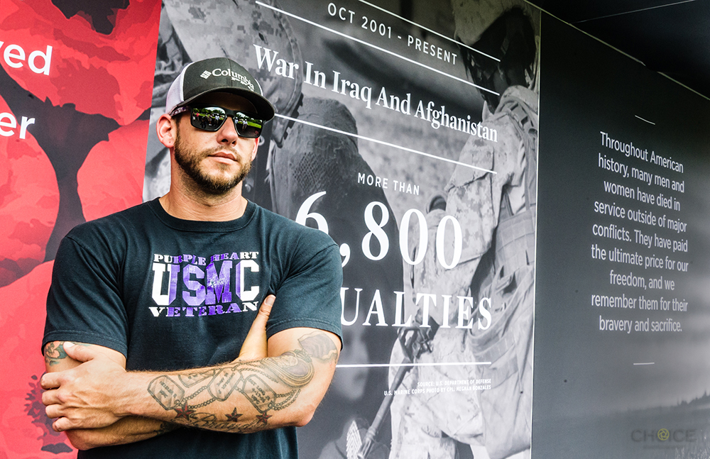 Purple Heart Marine Corps Veteran David Long, who served from 2005 to 2013 stands in front of exhibit at The Poppy Memorial, a temporary memorial made by USAA at the National Mall on May 27, 2018 in Washington, D.C. (Photo by Rodney Choice/AP Images for USAA)