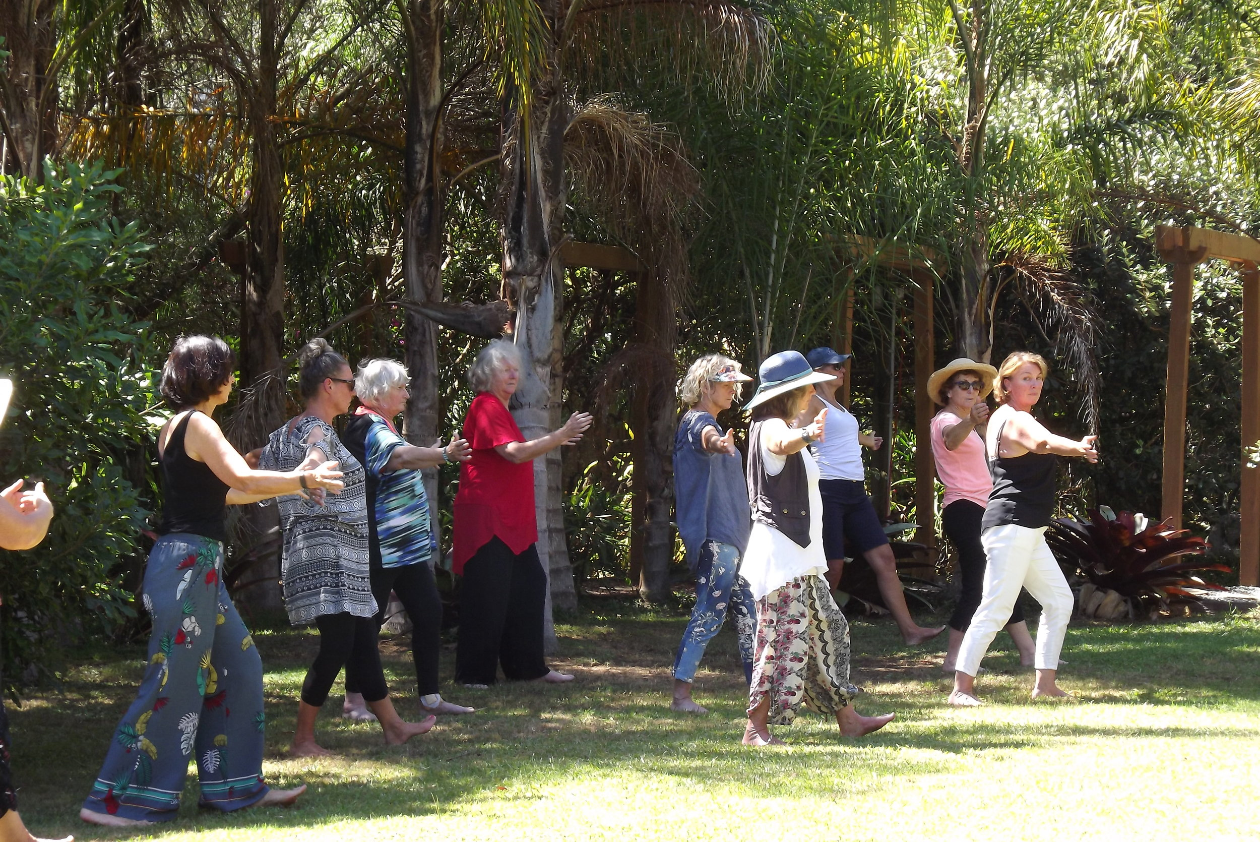 practising qi gong in the grounds of tushita hermitage