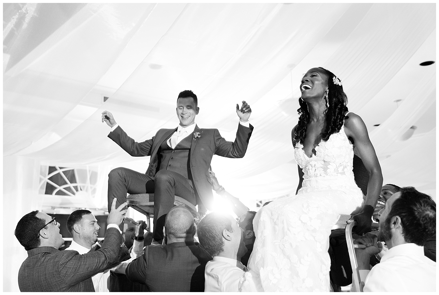 The bride was a little nervous about this part, but she safely returned to the ground after she was hoisted in to the air with her new husband to the sounds of the hava nagila!