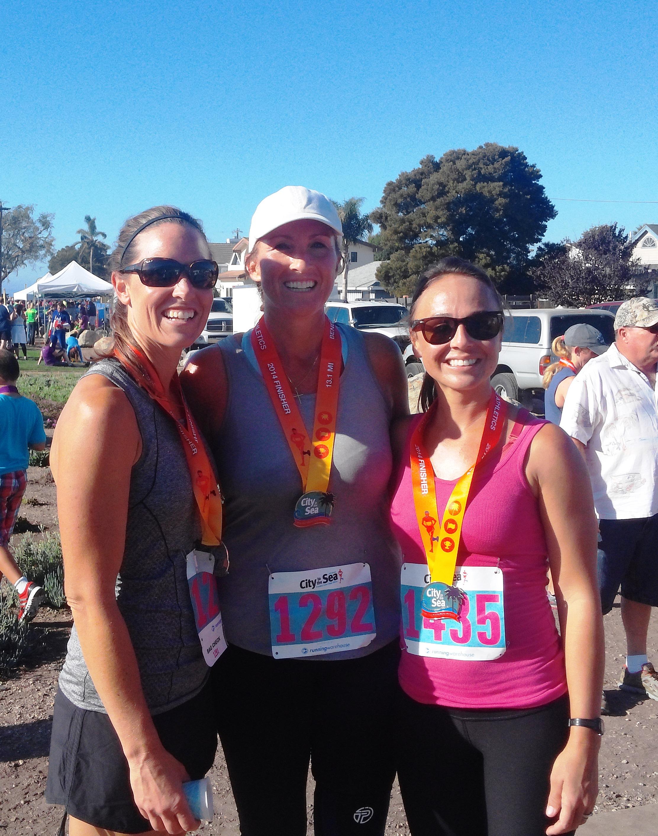 Hannah shipman (middle) finishing the City to Sea 1/2 Marathon!
