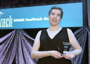 Debra Power accepts Ann Arbor SPARK Fast Track Award for Power Marketing Research