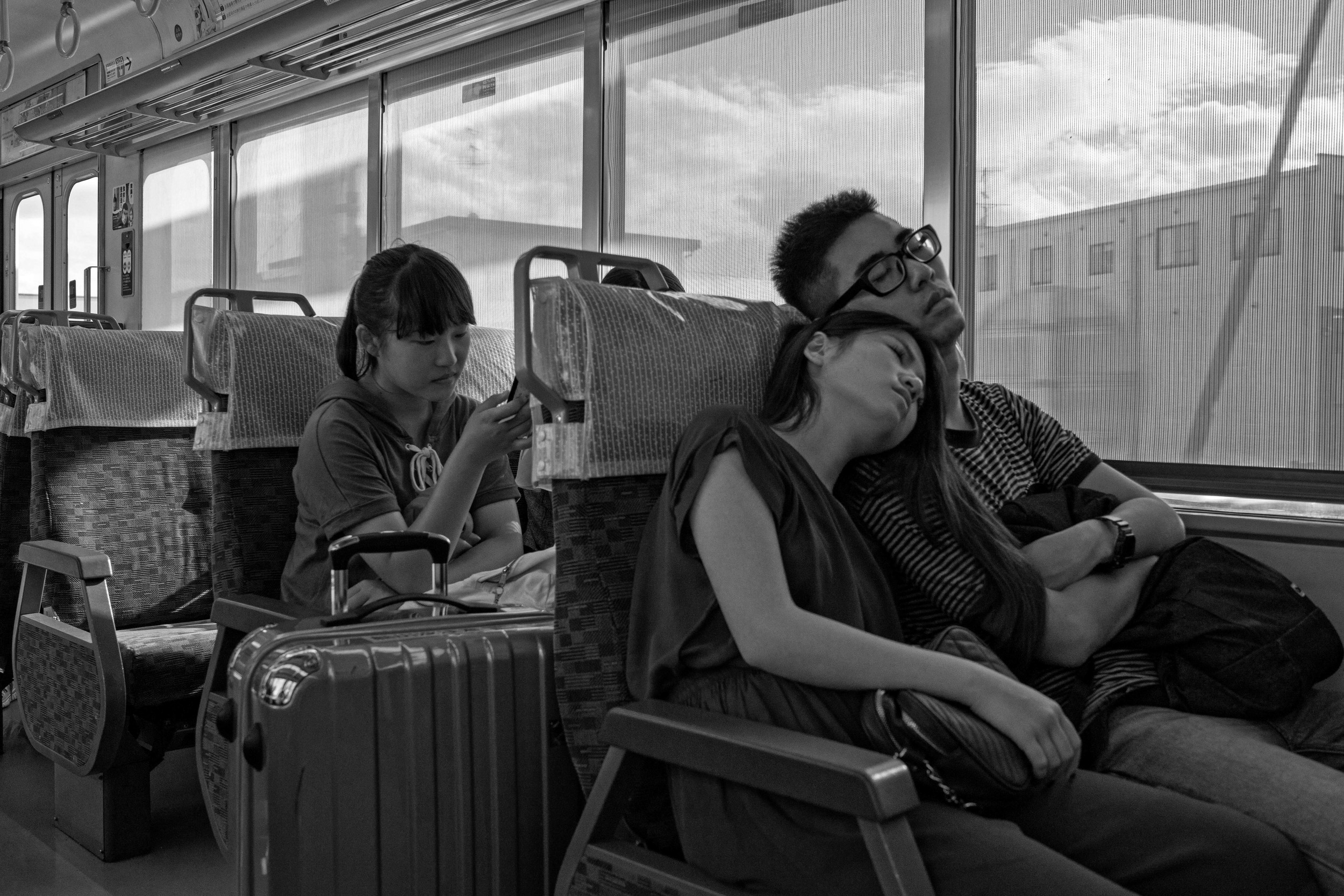 This was on a train from Nara to Kyoto. Obviously this one is more a matter of content than anything special photographically -- I might've been just as happy with a phone photo of the moment. I always feel self-conscious taking shots like this. That raises the question: Is it creepier to overtly grab shots like this with a big lens like the Distagon, or to be stealthy about it with something smaller? Shutter: 1/250th, f/6.3, ISO: 500.
