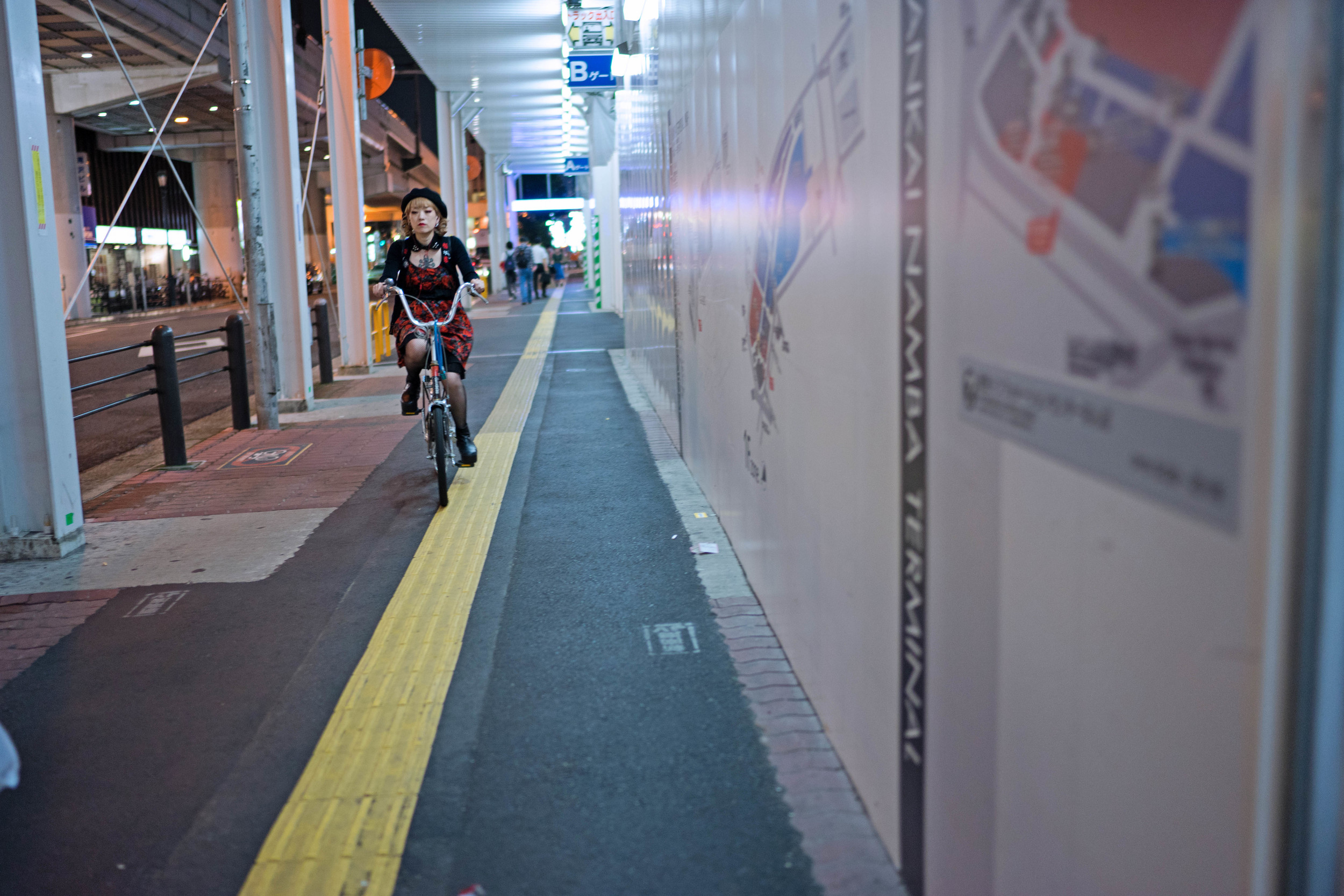 Another from Osaka, also wide open. There's a lot going on here between the bright lights and the bits of night in the background, but the lens did fine with all of it. The bicyclist isn't as sharp as she could be, but that was only due to her movement, and my zone-focusing being a tad off. Shutter: 1/100th, f/1.4, ISO: 500.