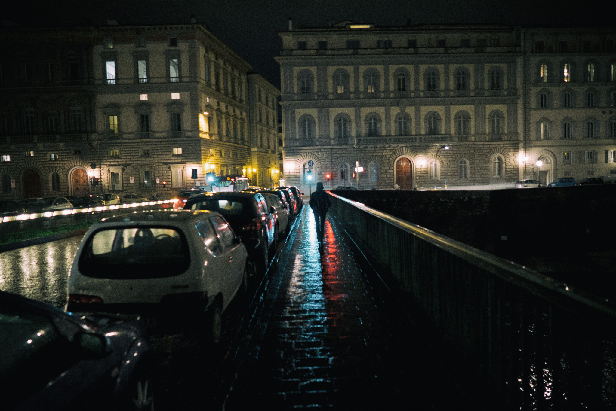 f/2.5, shutter 1/50th, and ISO 2000. Florence is often drizzly in January, but as film noir cinematographers discovered long ago, that's great for shooting streets and sidewalks at night.