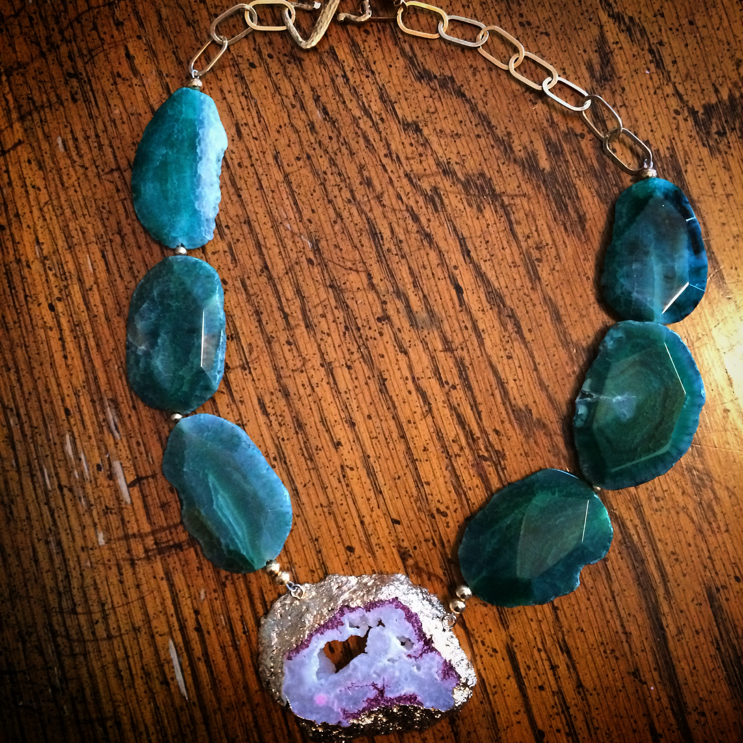 I recently found this amazing jewelry designer of    TherArt    and    Le Obsession Boutique    owner on Instagram,   Teresa Habczyk  . She makes the most AMAZING pieces and I am so happy to have found her. This gorgeous   emerald green agate freeform and pink and white druzy crystal necklace   was the most important accessory at my engagement party last weekend (well, besides my handsome fiance of course!)  I paired it with a light pink romper with black lace, sheer black tights, and black lace pumps. The amount of compliments I received on my fabulous neck accessory was out of this world! Scroll down to check out more pics, the outfit, and more about the designer herself. Then  shop online here:   https://www.etsy.com/shop/teresajewelry