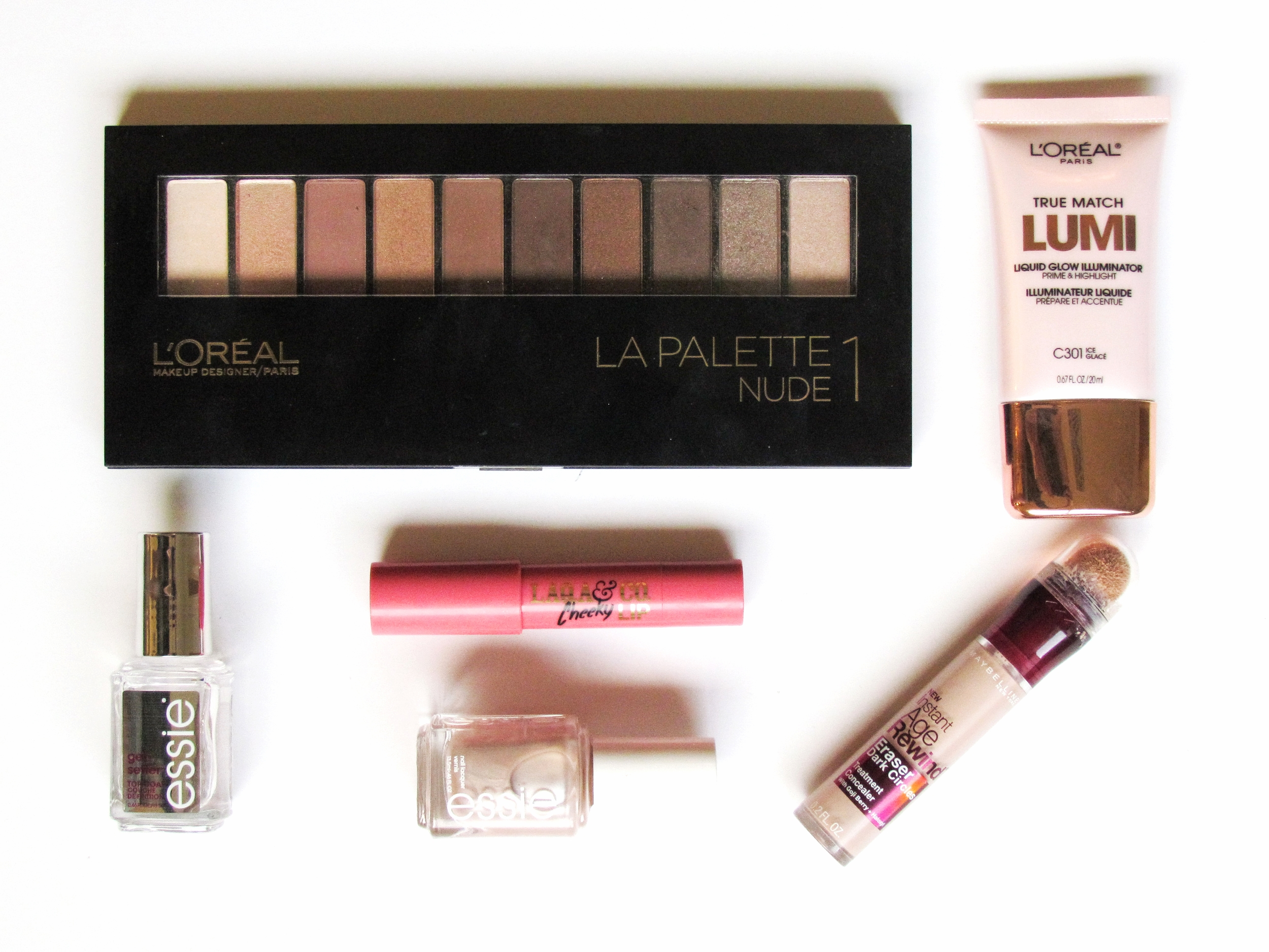 L'Oreal La Palette Nude 1, Essie Gel top coat, Essie pearl polish in Imported Bubbly, LAQA cheek and lip balm, Maybelline New York under eye brightening concealer, and L'Oreal Lumi highlighter in Ice - Southern New Yorker - August Favorites