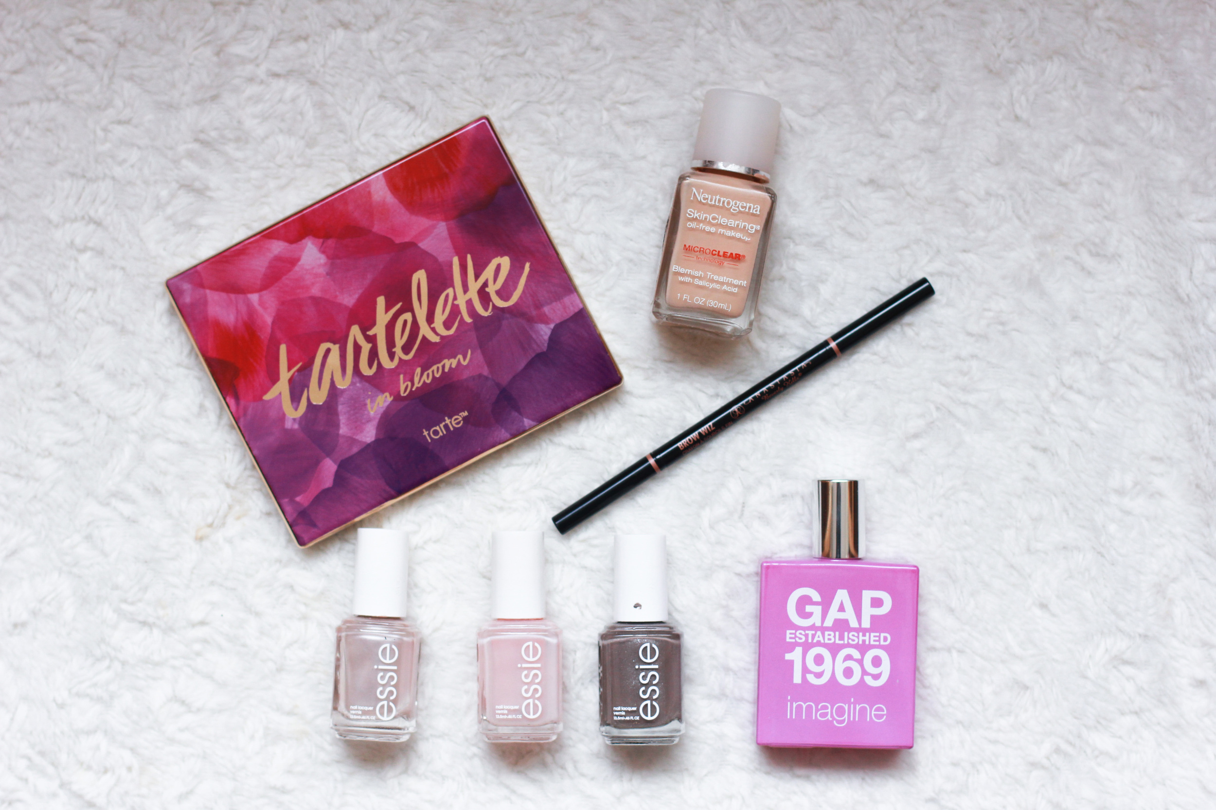 Tartelette in bloom eye shadow palette, Neutrogena skin clearing foundation, anastasia beverly hills brow wiz in taupe, Essie nail polish in imported bubbly, mochachino, and hi daddy, gap imagine perfume