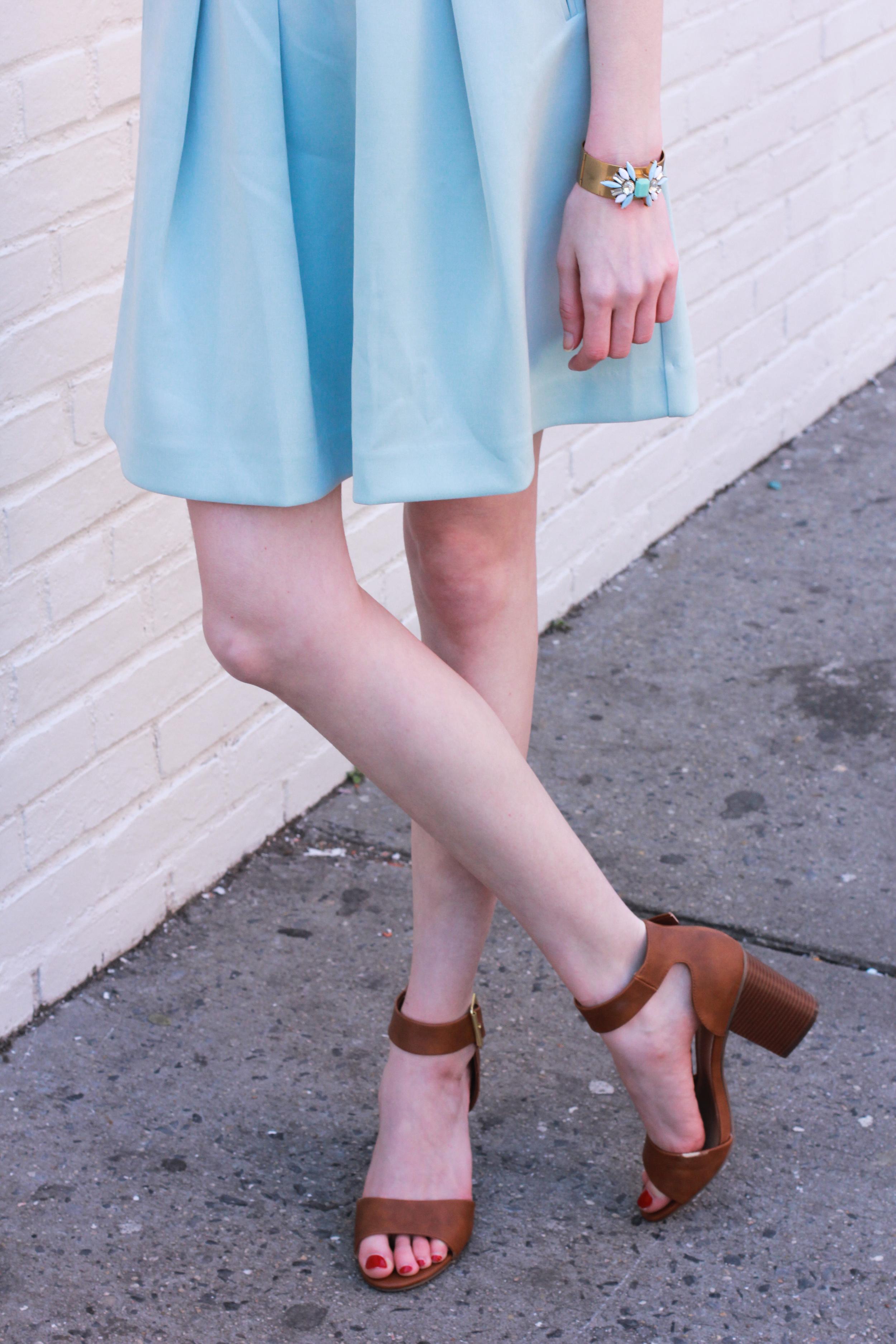 LOFT pleated serenity blue skirt, J.Crew grid windowpane pattern button down, J.Crew gold and jewel cuff, Target brown block heeled sandals, Clinique Love Pop lipcolor