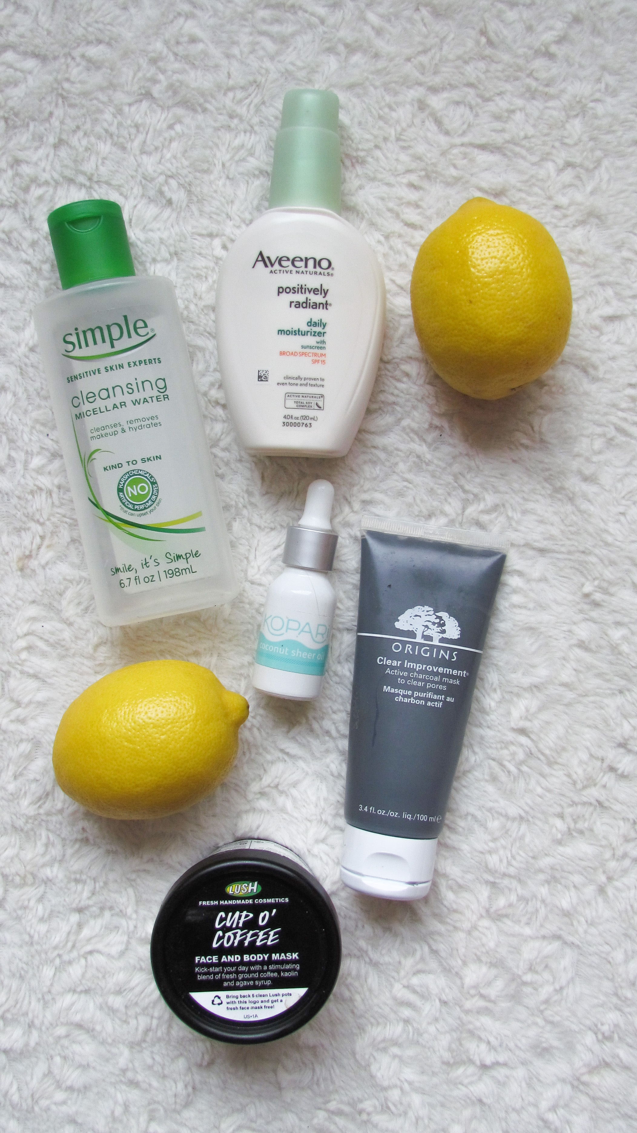 The Skincare Edit - Simple Micellar Water, Aveeno Daily Moisturizer, Kopari Sheer Coconut Oil, Origins charcoal face mask, LUSH cup o' coffee face mask scrub