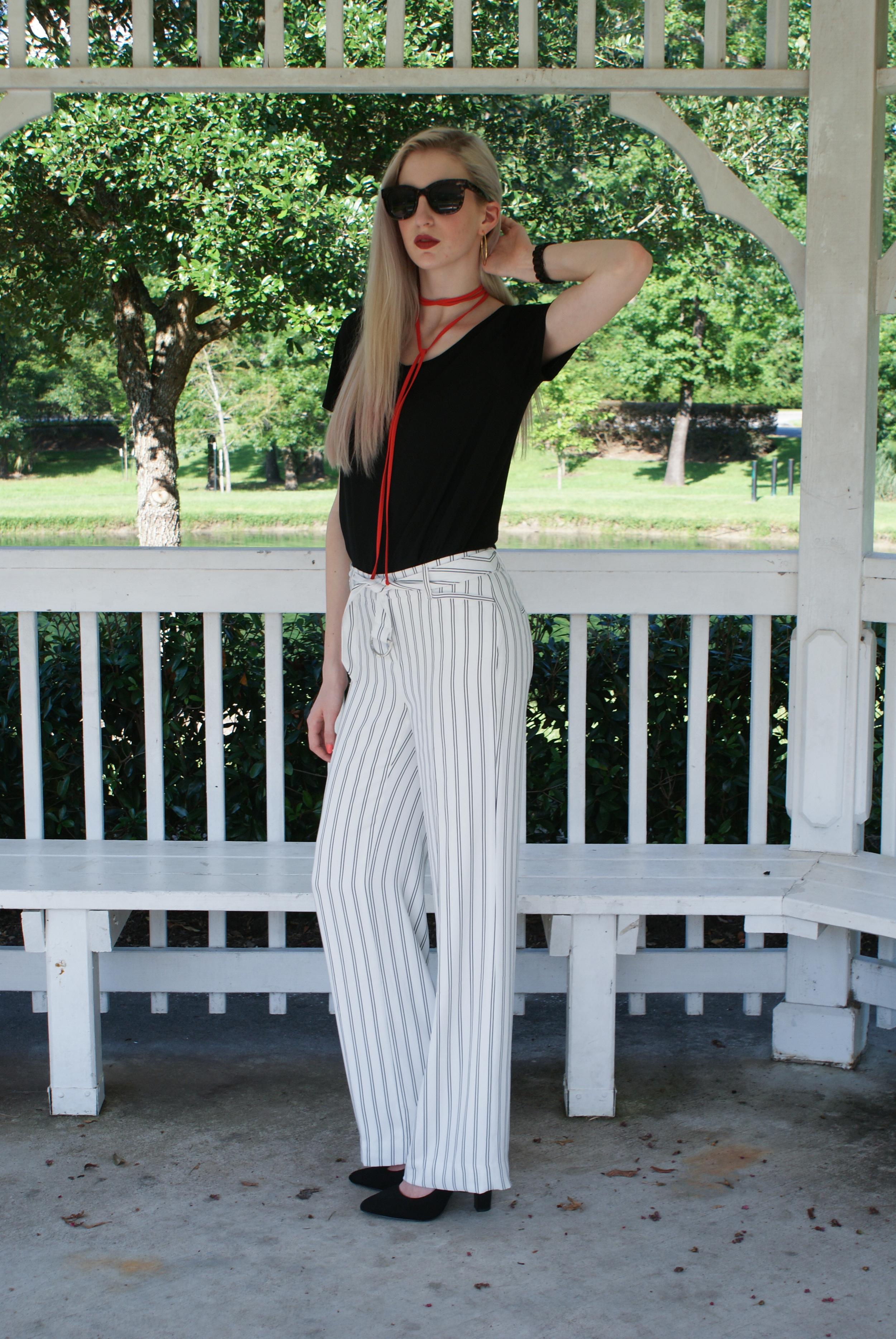 LOFT black tee, White House Black Market 70's style wide leg striped pants, pointed toe pump heel, long collar tie necklace, gold hoop earrings, clinique cola pop lipstick, tim ryan fringe jacket
