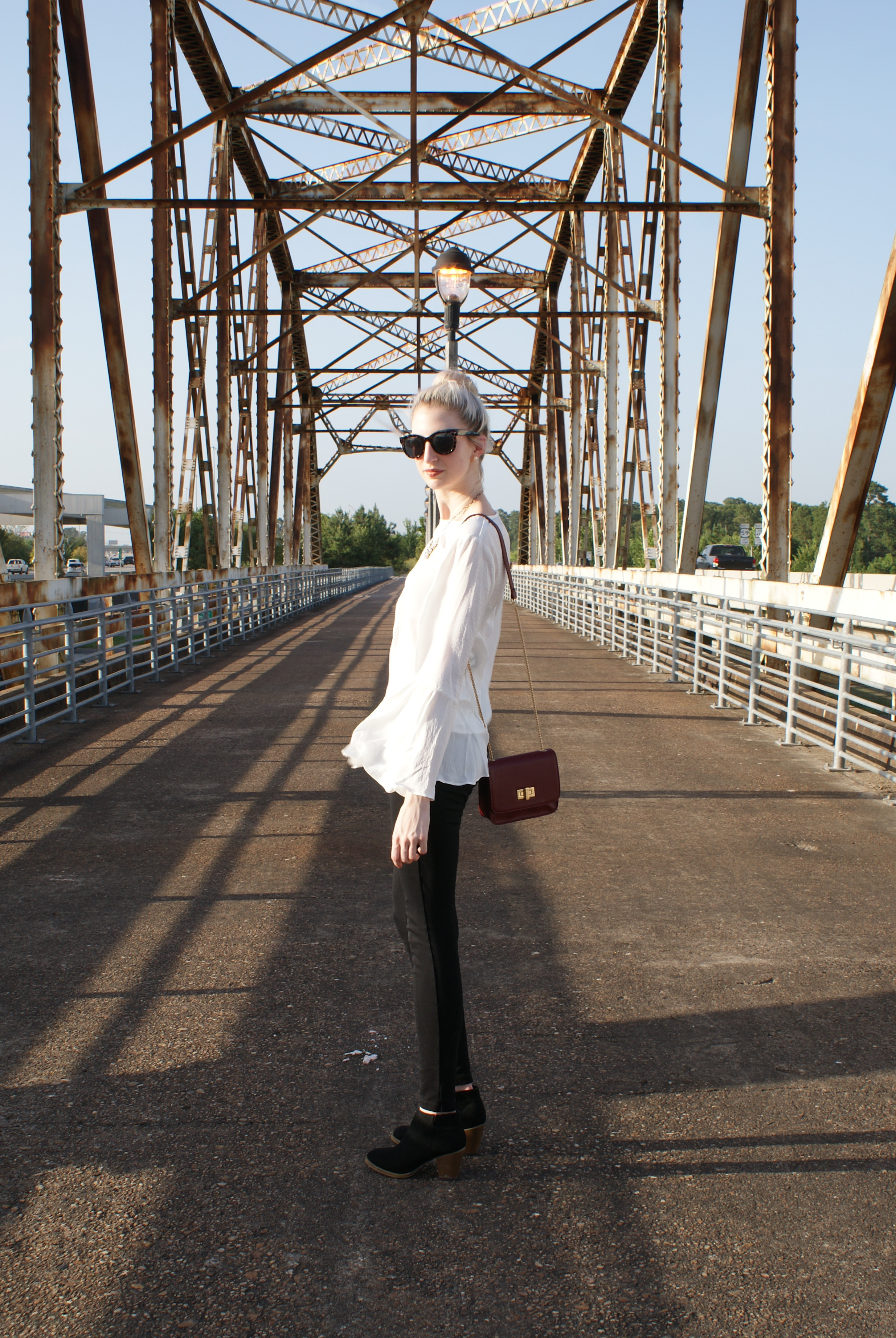 WhoWhatWear for Target collection white bell sleeve blouse and red chain strap micro bag, J.Crew snap-front pixie pants, Steve madden block heel black ankle boots, LOFT crystal necklace