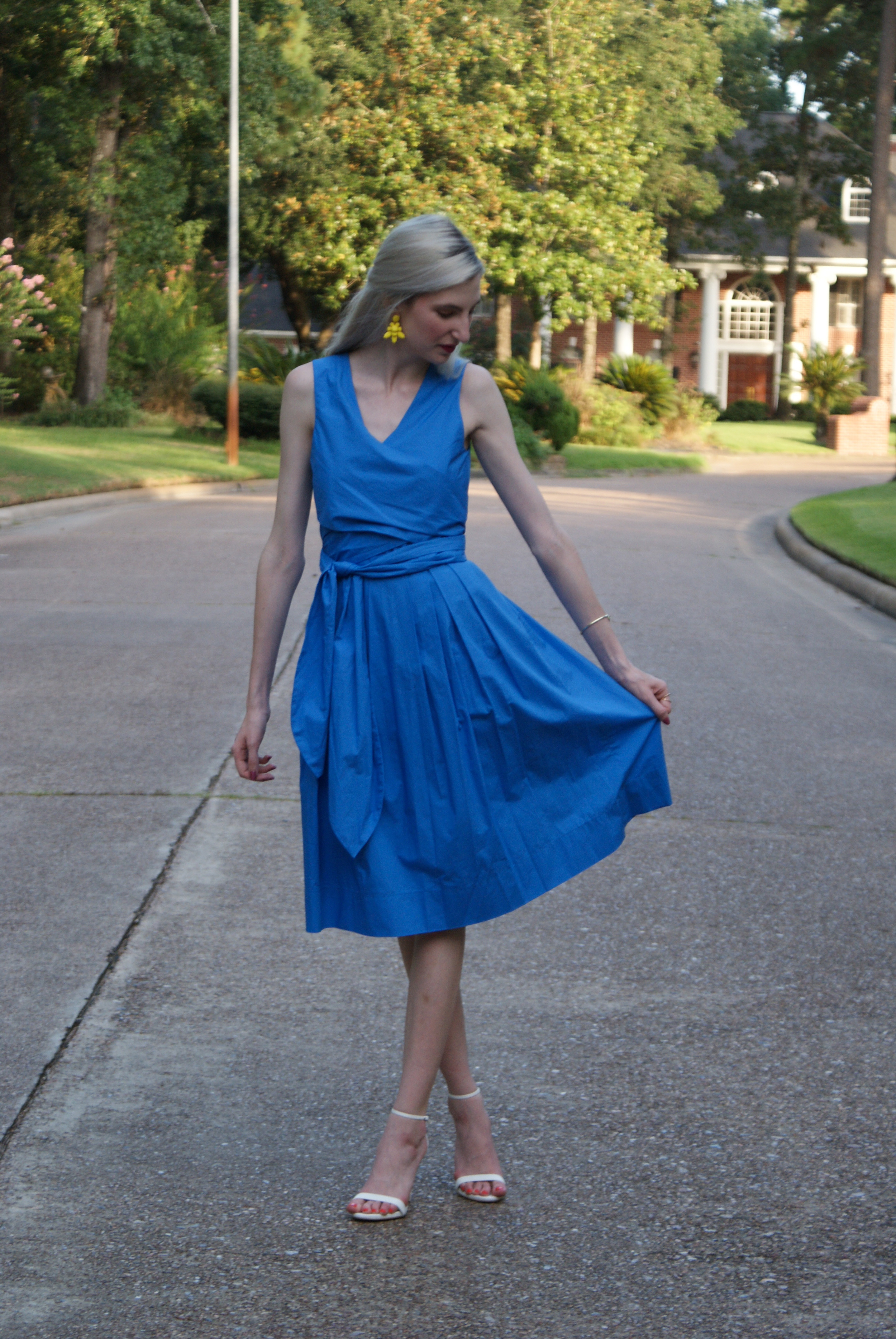 J.Crew blue wrap dress, J.Crew yellow statement earrings, white steve madden stecy ankle strap heeled sandal, kendra scott andy station cuff, revlon ultra hd matte lipstick in devotion