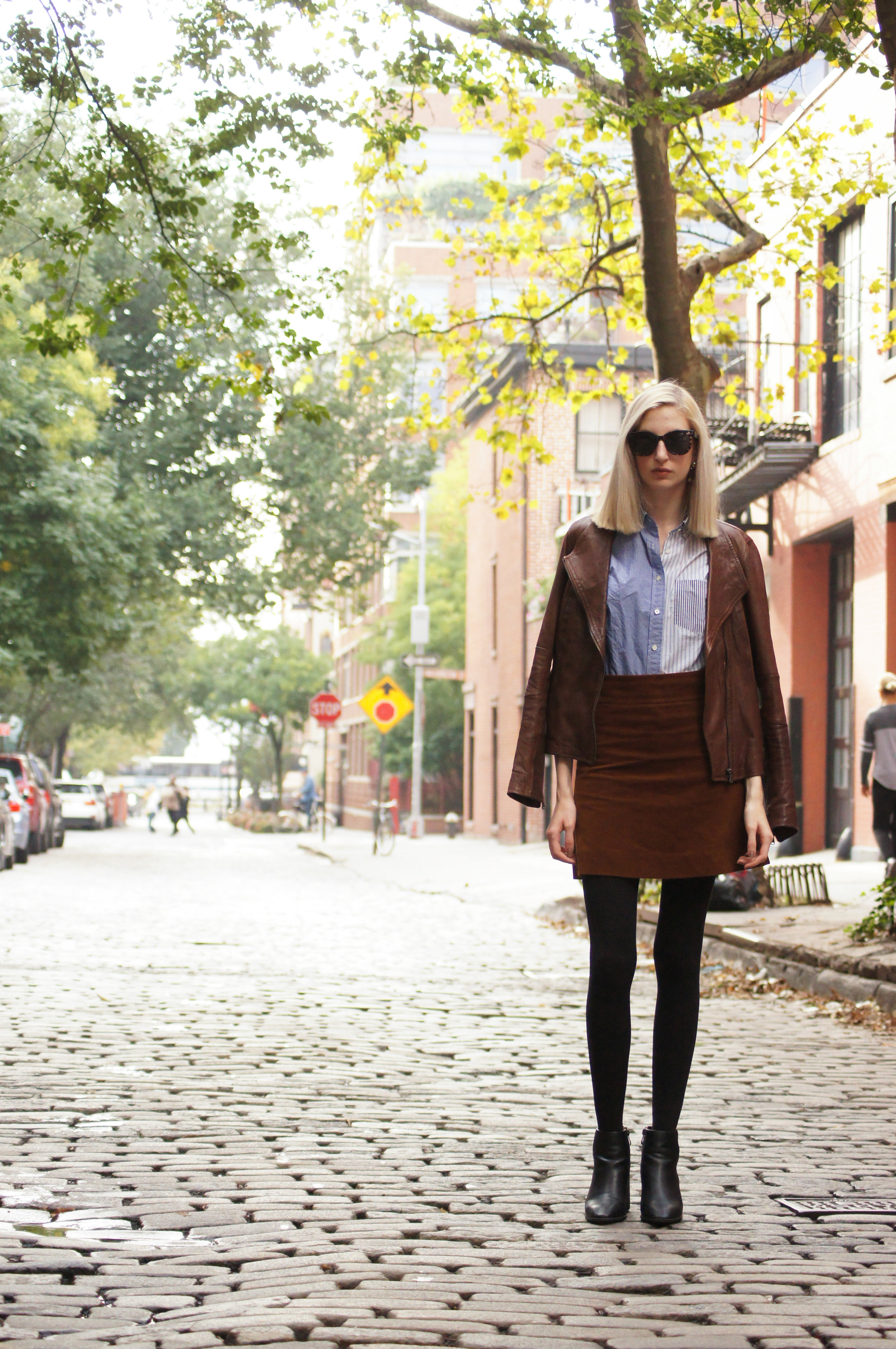 J.Crew corduroy skirt, cocktail shirt, and crystal fan earrings, block heel black ankle boots, brown leather jacket - Audra Koch
