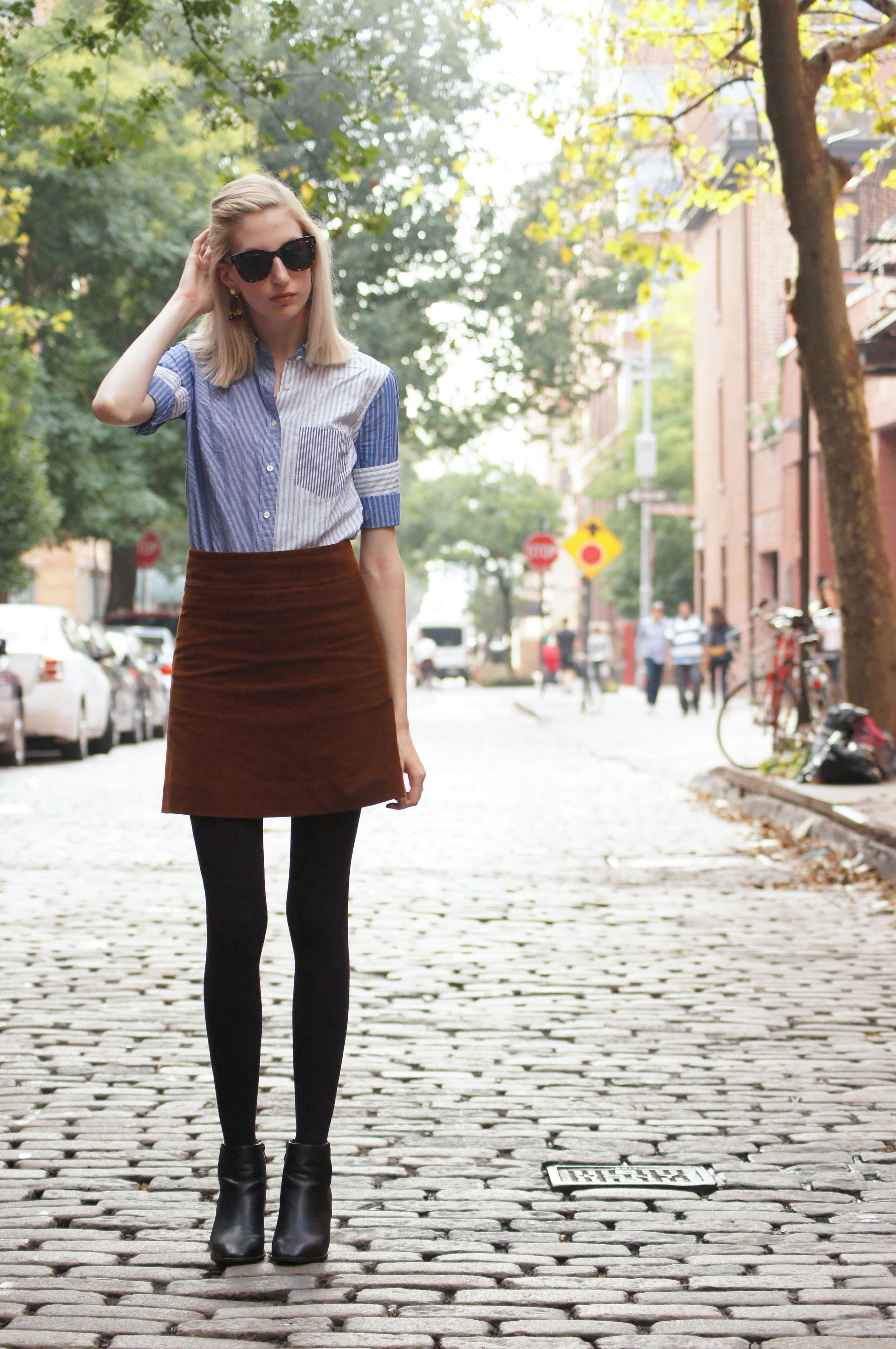 J.Crew corduroy skirt, cocktail shirt, and crystal fan earrings, block heel black ankle boots, brown leather jacket