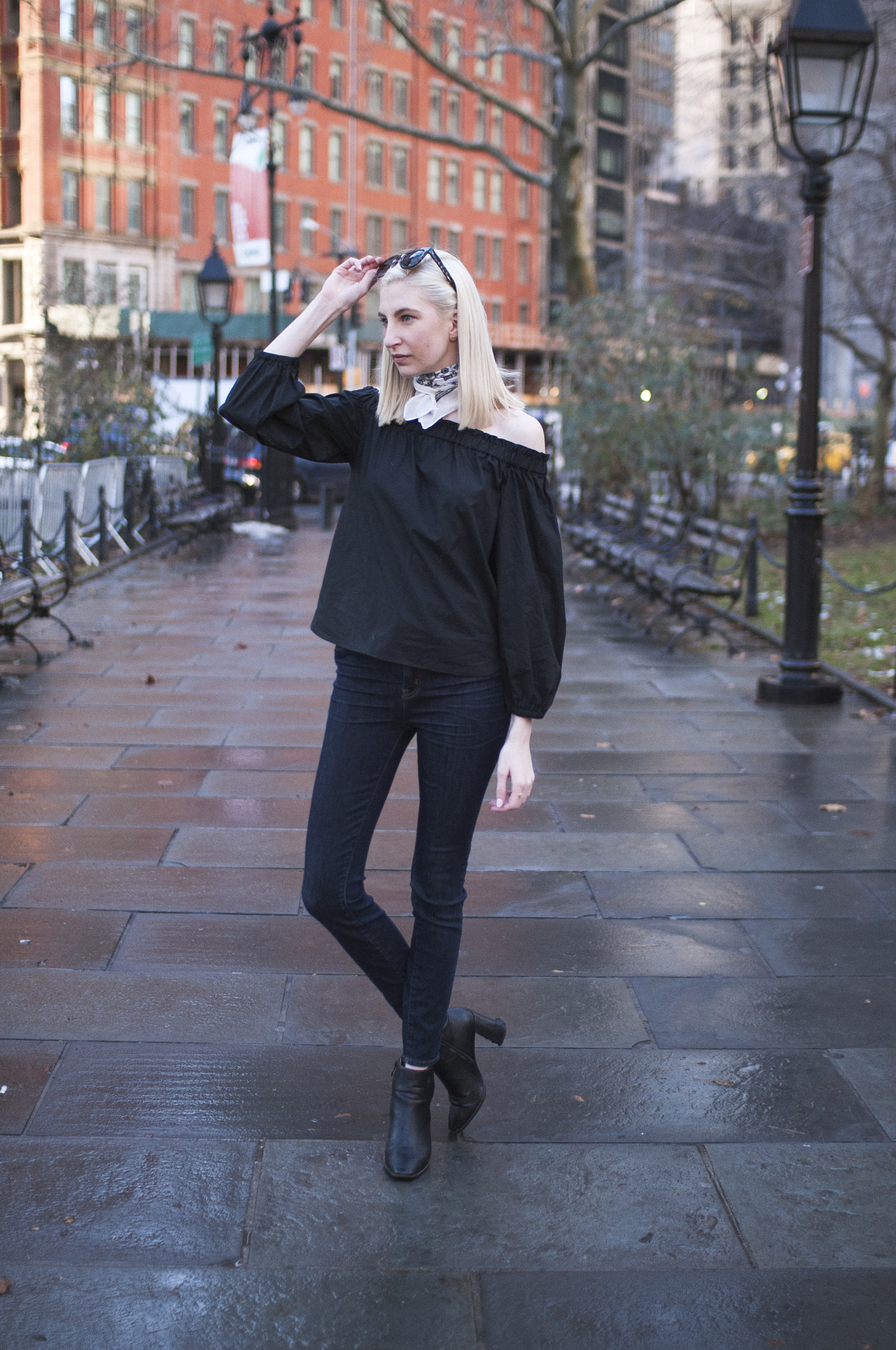 Audra Koch J.Crew black longsleeve off the shoulder top, lookout high rise jeans, black block heel ankle boots, white bandana neck scarf, ear crawlers from Rocksbox