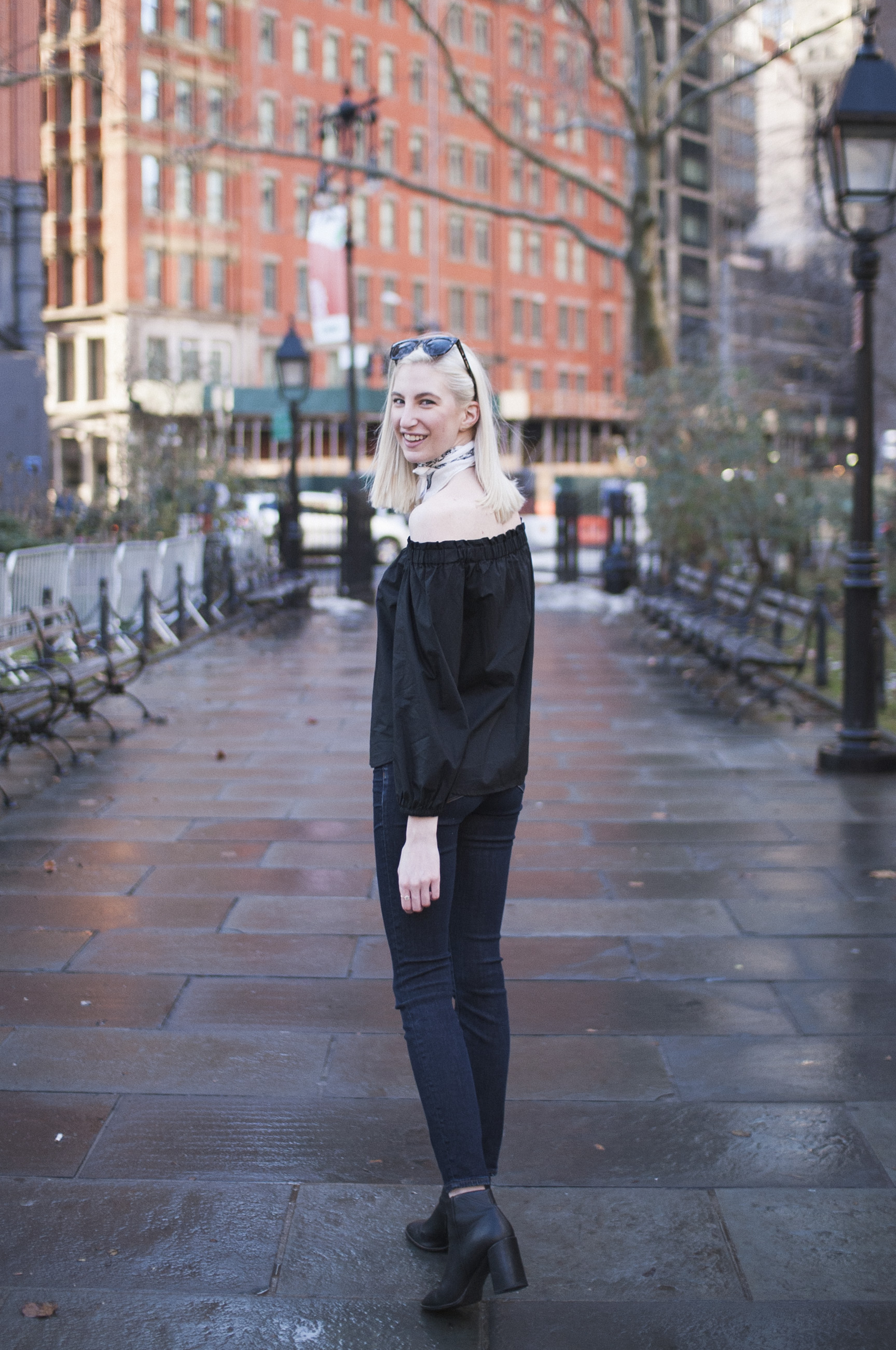 Audra Koch - J.Crew black longsleeve off the shoulder top, lookout high rise jeans, black block heel ankle boots, white bandana neck scarf, ear crawlers from Rocksbox