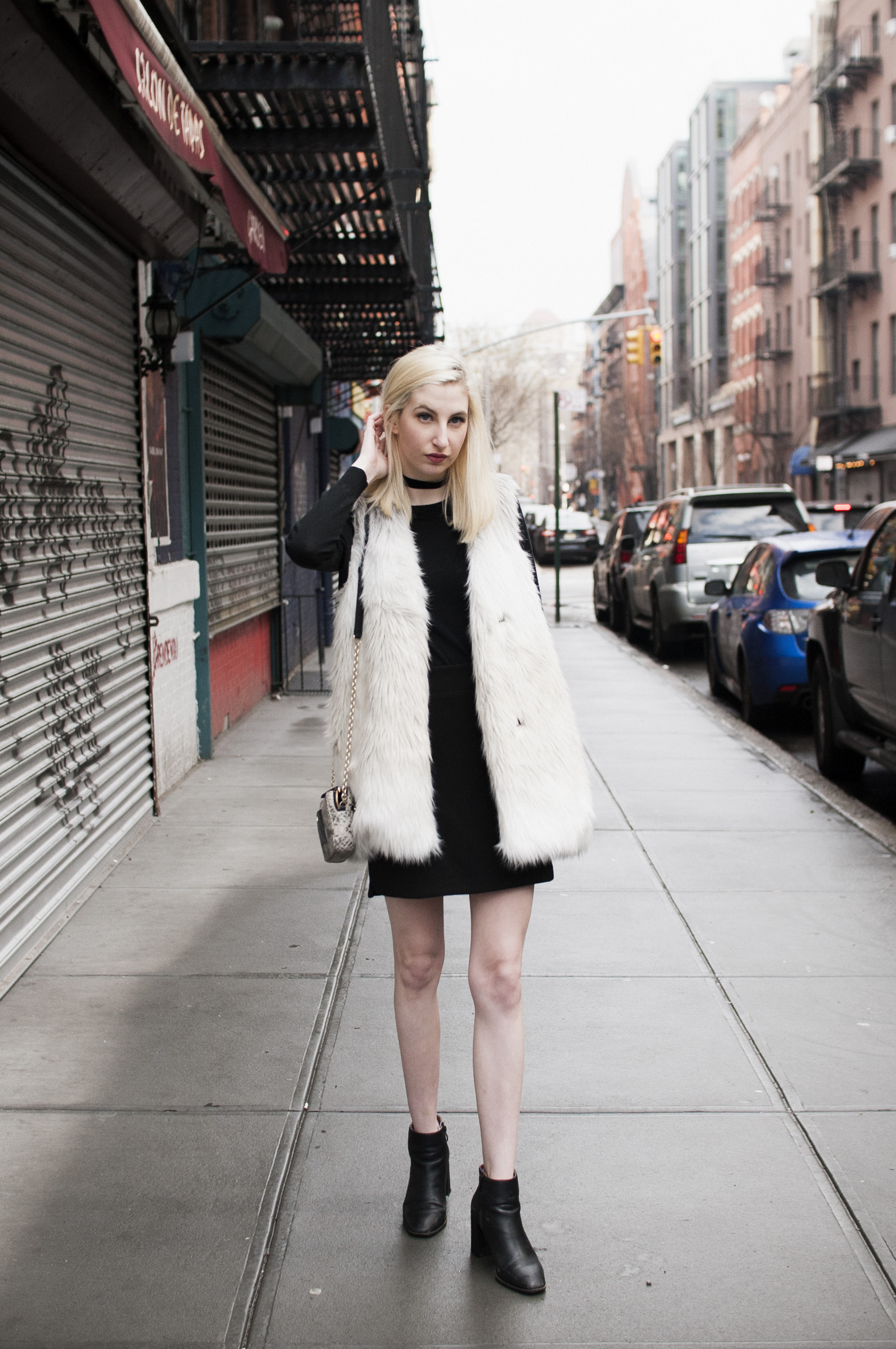 White and Grey faux fur vest, black block heel ankle booties, black velvet choker, blonde hair, new york city