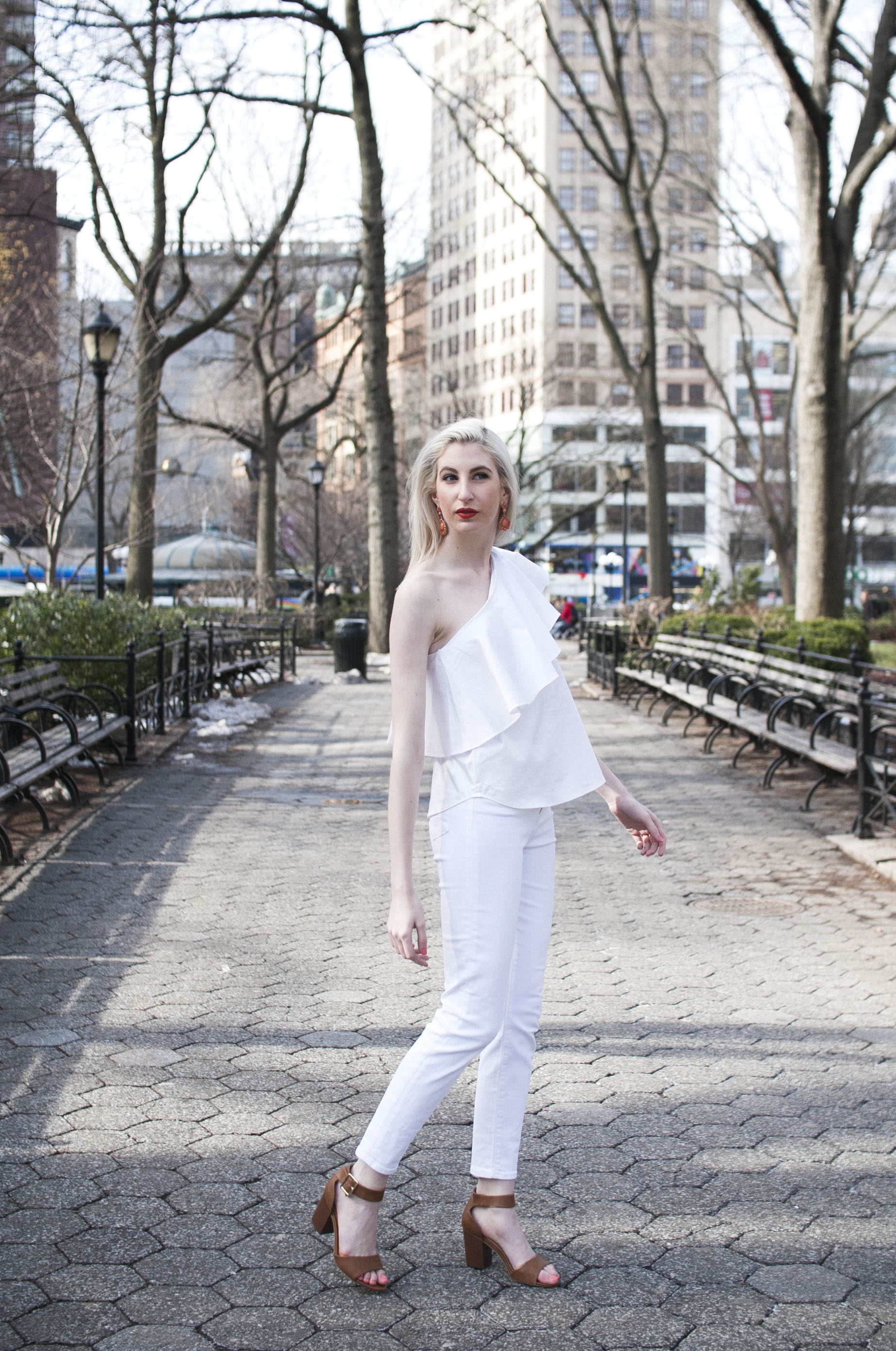 white jeans, Zac by Zac Posen off the shoulder ruffle top, block heeled ankle strap sandals, orange lipstick, all white outfit