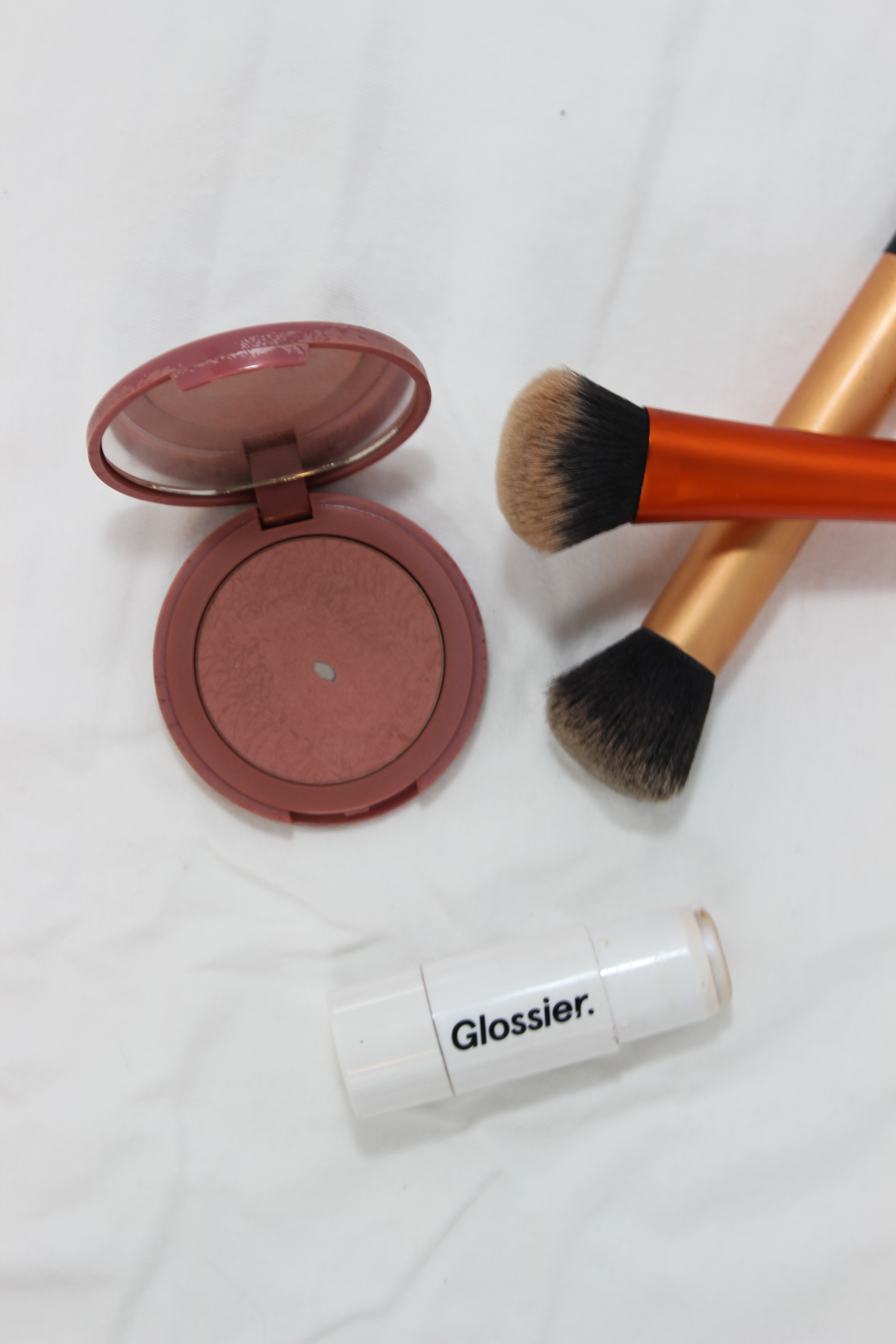 Tarte Amazonian Clay Blush in Exposed, Glossier Haloscope in Moonstone, Milk Makeup Bronzer in Baked