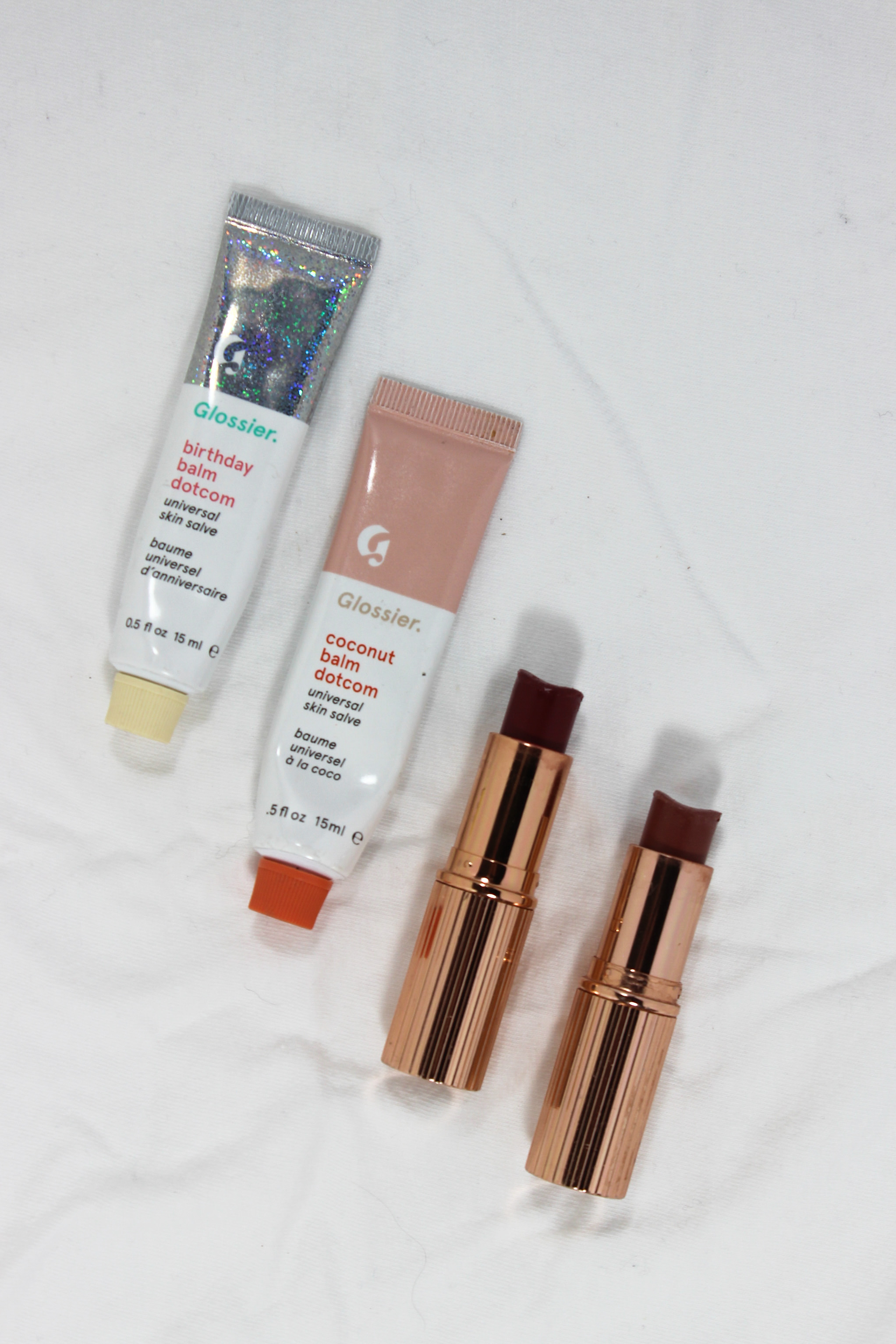 Glossier Balm Dotcom in coconut and birthday cake, Charlotte Tilbury lipstick in Bond Girl and Very Victoria