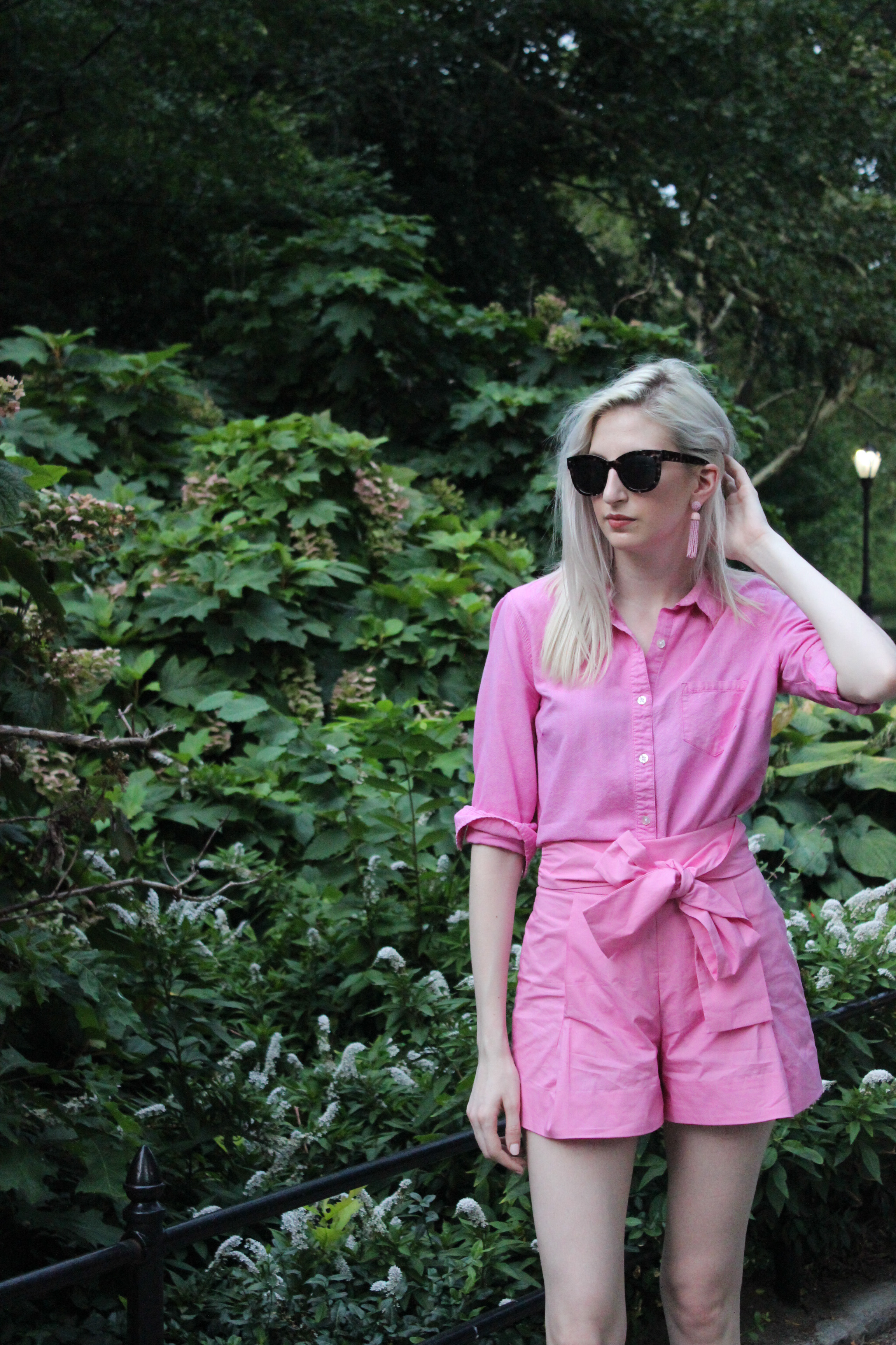 J.Crew hot pink bow tie shorts, pink button down, heeled sandals, and tassel earrings. All pink monochrome outfit. elle woods style