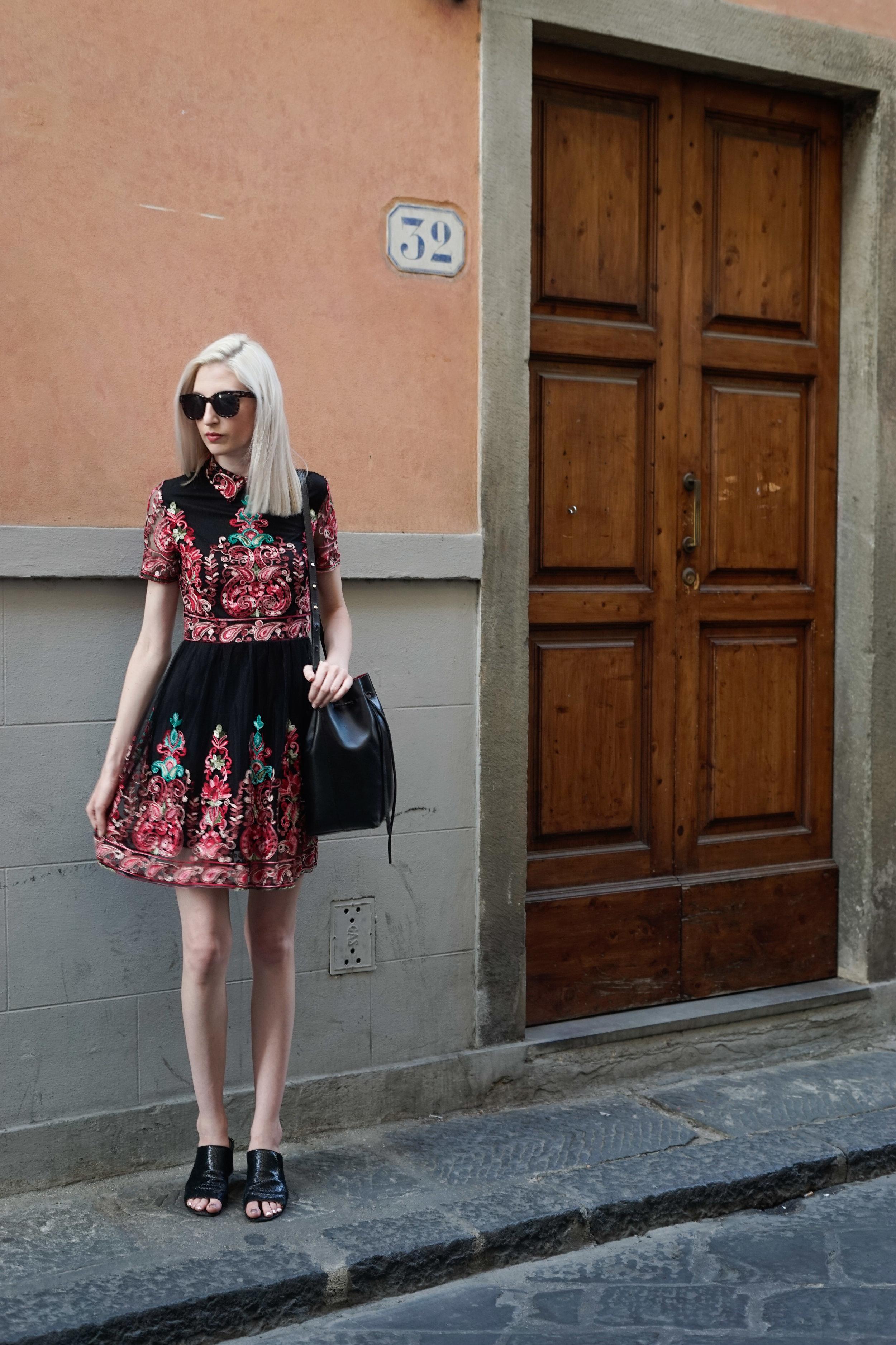 embroidered skater dress, black block heeled mules, black Mansur Gavriel bucket bag